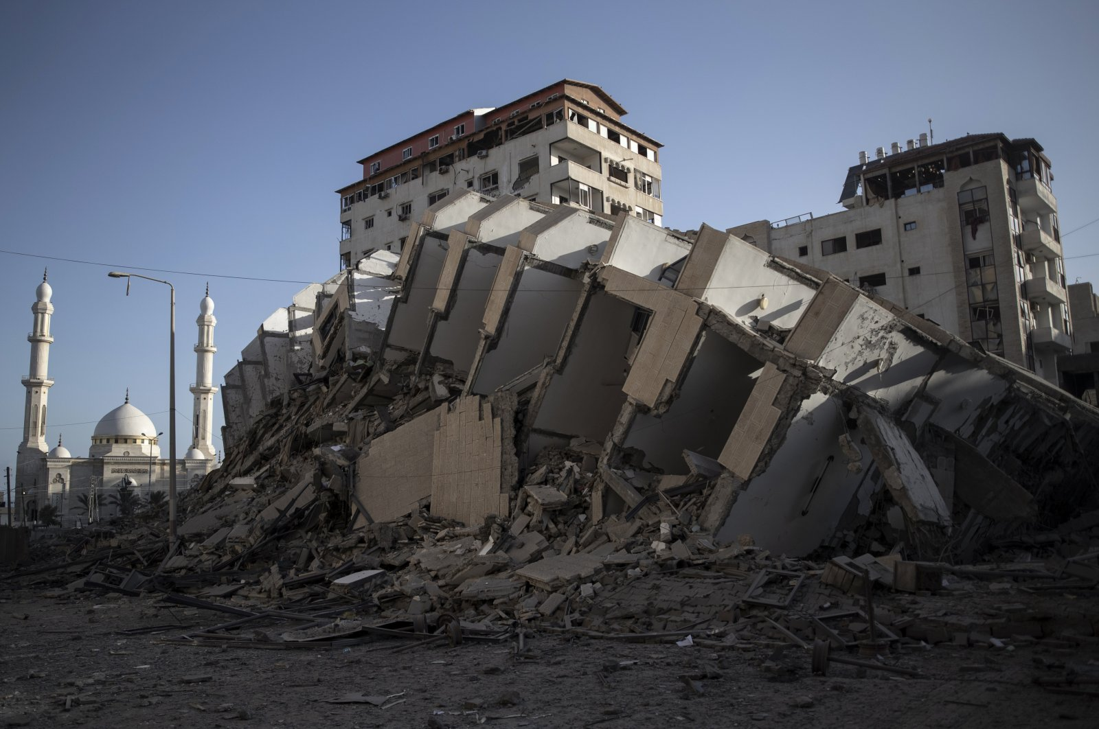 The remains of a building destroyed by Israeli airstrikes on Gaza City, Wednesday, May 12, 2021. (AP Photo)