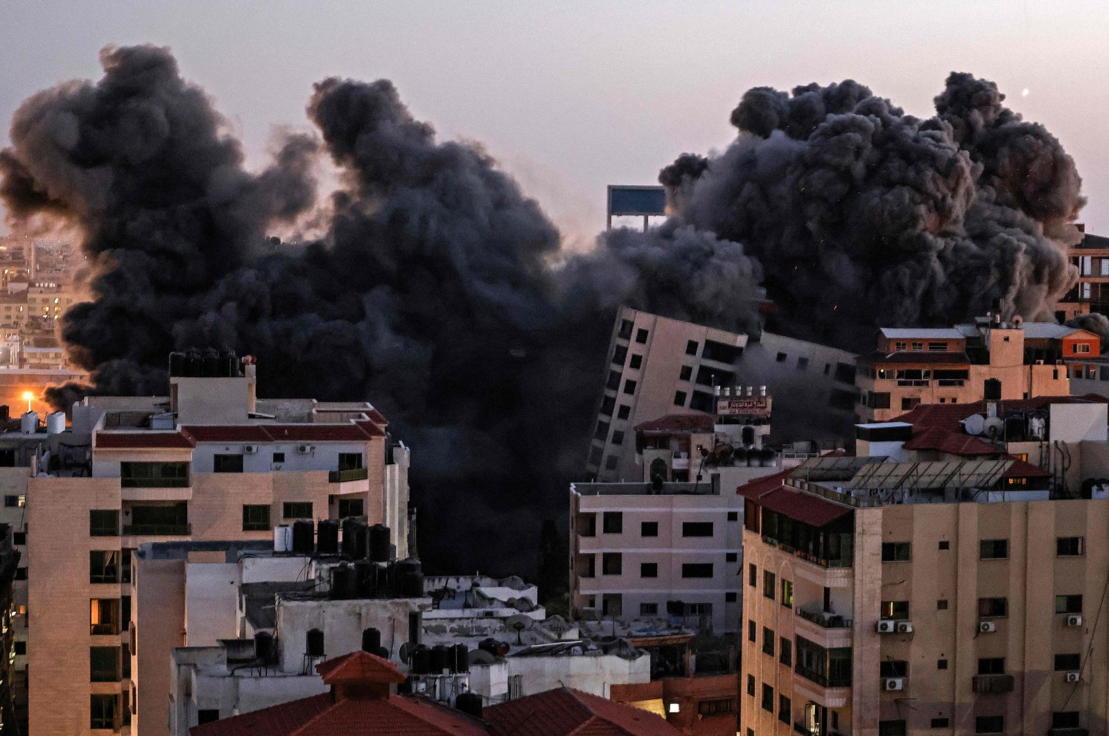 Smoke billows from an Israeli airstrike on the Hanadi compound in Gaza City, the Gaza Strip, Palestine, May 11, 2021. (AFP Photo)