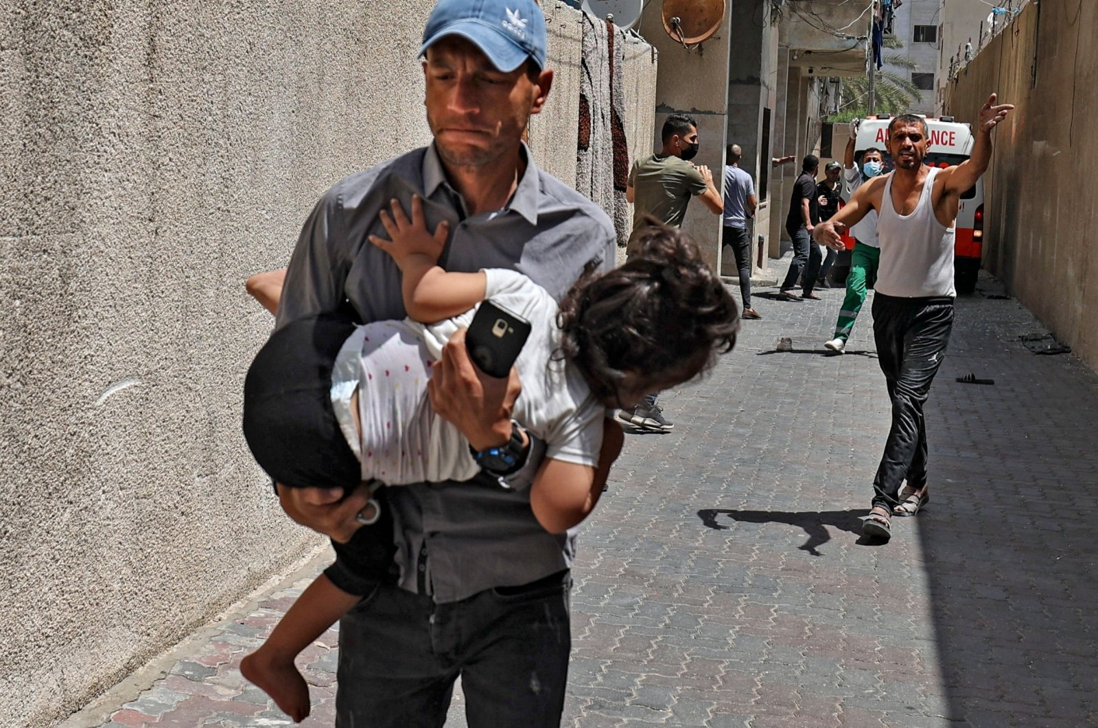 Palestinians evacuate a building targeted by Israeli bombardment in the Gaza Strip, Palestine, May 11, 2021. (AFP Photo)