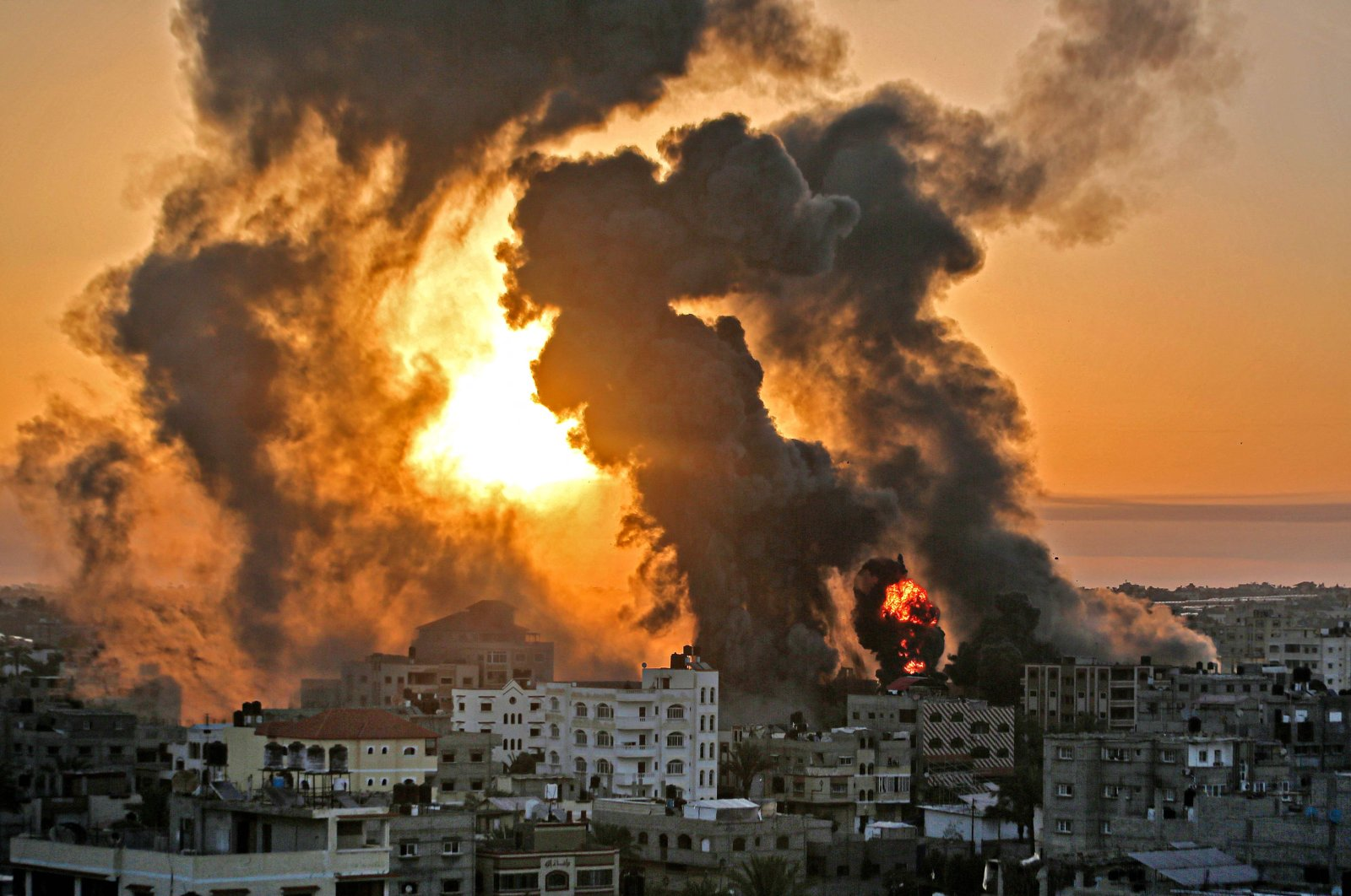 A fire rages at sunrise following an Israeli airstrike in Khan Yunish, southern Gaza Strip, Palestine, May 12, 2021. (AFP Photo)