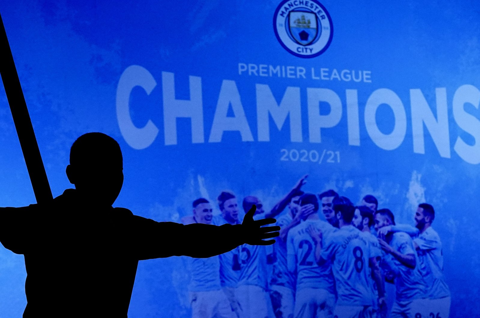 A Manchester City supporter celebrates outside the Etihad Stadium after his team clinched the English Premier League title, Manchester, England, May 11, 2021. (AP Photo)