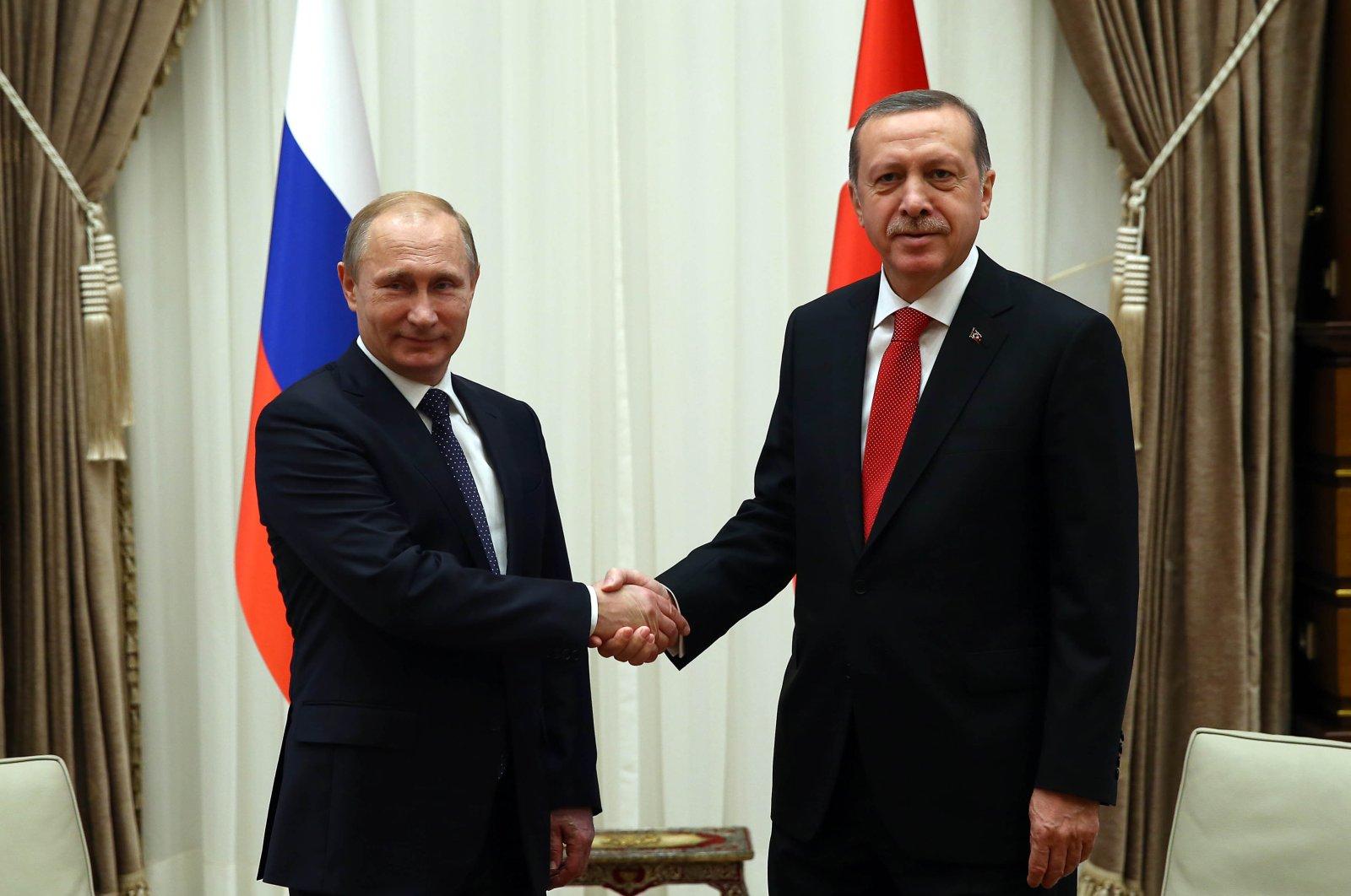Russian President Vladimir Putin President (L) and President Recep Tayyip Erdoğan shake hands during a meeting, Istanbul, Turkey, Dec. 1, 2014. (Courtesy of the Turkish Presidency)