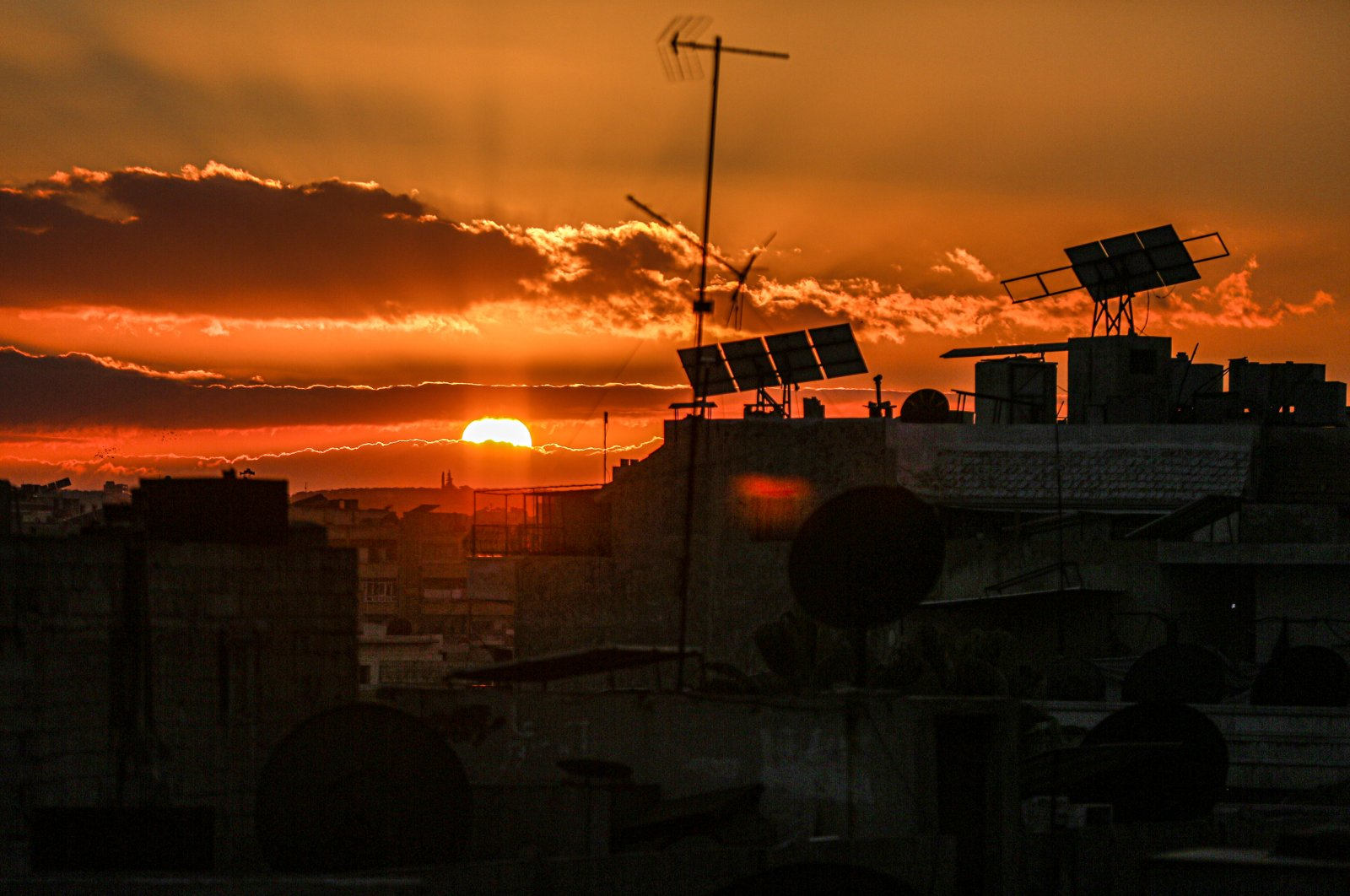 A sunset seen over the Idlib province, northern Syria, Feb. 15, 2021. (Photo by Getty Images)