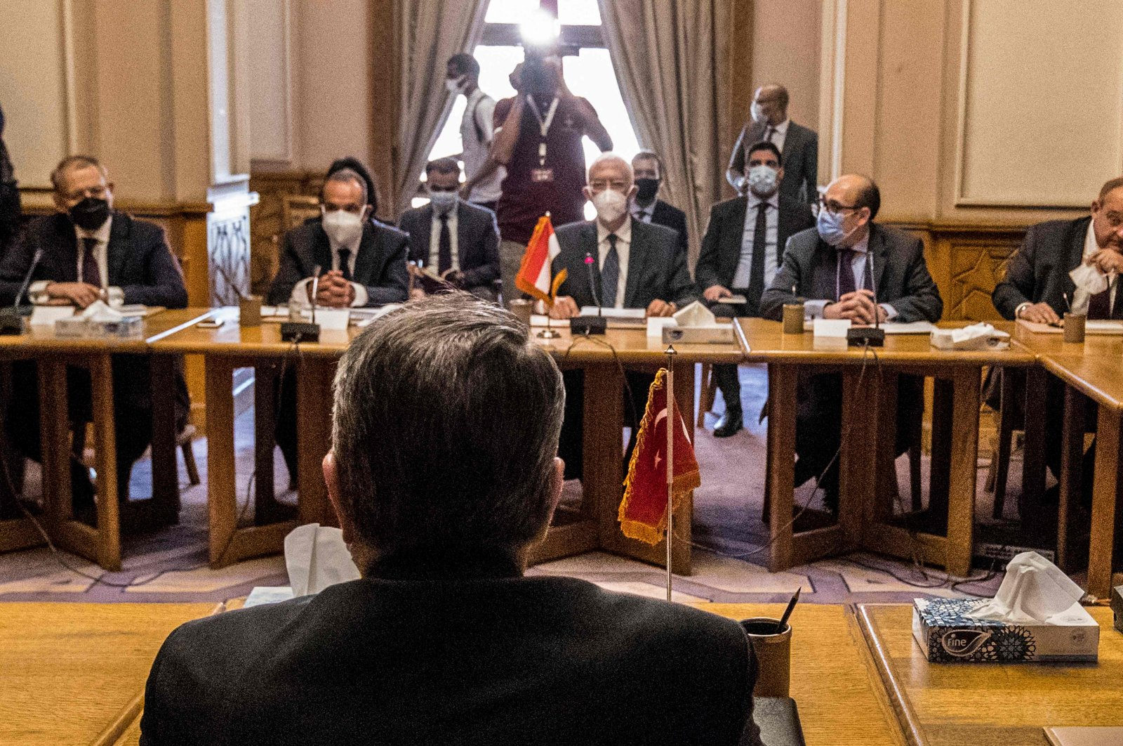 Egypt's Deputy Foreign Minister Hamdi Sanad Loza (background) meets with his Turkish counterpart Sedat Önal (Foreground) in the foreign ministry headquarters in the Egyptian capital Cairo, May 5, 2021. (AFP Photo)