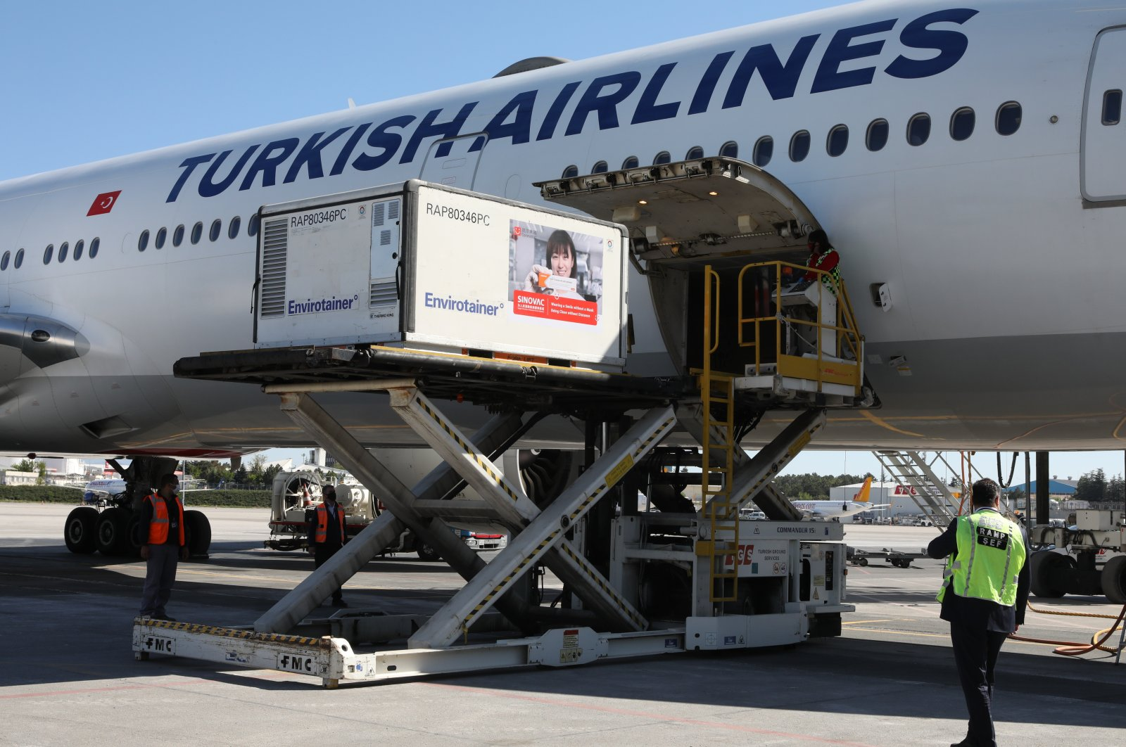 A container carrying CoronaVac being unloaded from an airplane, at Esenboğa Airport, in the capital Ankara, Turkey, May 12, 2021. (AA PHOTO)