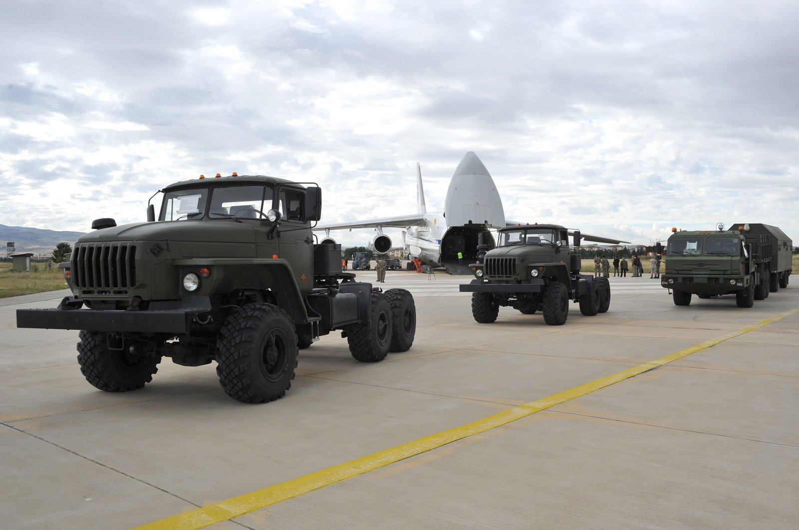 A handout photograph taken and released on July 12, 2019, by the Turkish Defense Ministry shows a Russian military cargo plane carrying the S-400 missile defense system from Russia to the Mürted military air base, in Ankara, Turkey. (AFP File Photo)