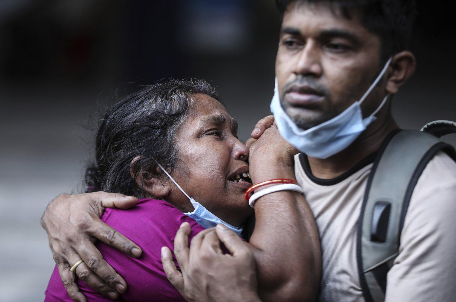 A Bangladeshi woman mourns the death of her husband who died of COVID-19 at a hospital in Dhaka, Bangladesh, May 7, 2021. (Mahmud Hossain Opu via AP)