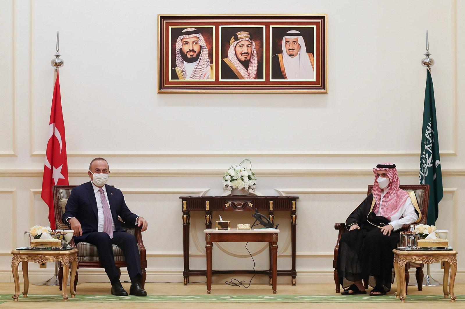 Foreign Minister Mevlüt Çavuşoğlu (L) meets with Saudi Foreign Minister Prince Faisal bin Farhan in Jeddah, Saudi Arabia, May 11, 2021. (AA Photo)