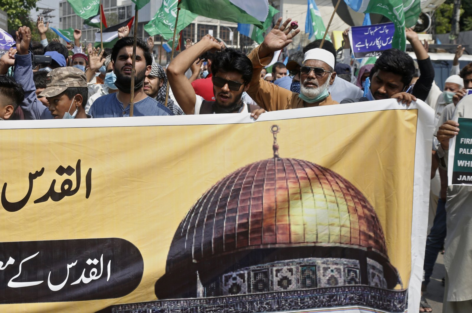 Supporters of the Pakistani religious group Jamaat-e-Islami chant slogans during a rally to condemn Israel's use of force against the Palestinians at the Al-Aqsa mosque compound in Jerusalem, in Lahore, Pakistan, Wednesday, May 12, 2021. (AP Photo/K.M. Chaudary)
