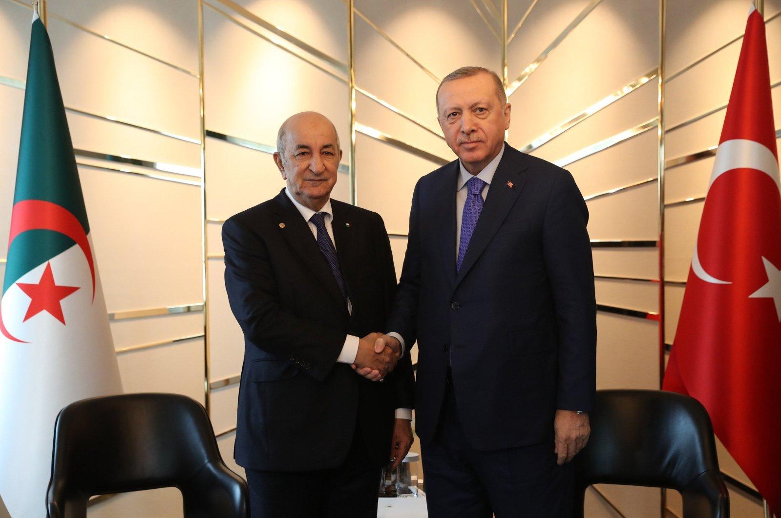 Turkish President Recep Tayyip Erdoğan (R) shakes hands with Algerian President Abdelmadjid Tebboune ahead of a conference on Libya in Berlin, Germany, Jan. 21, 2020. (IHA)