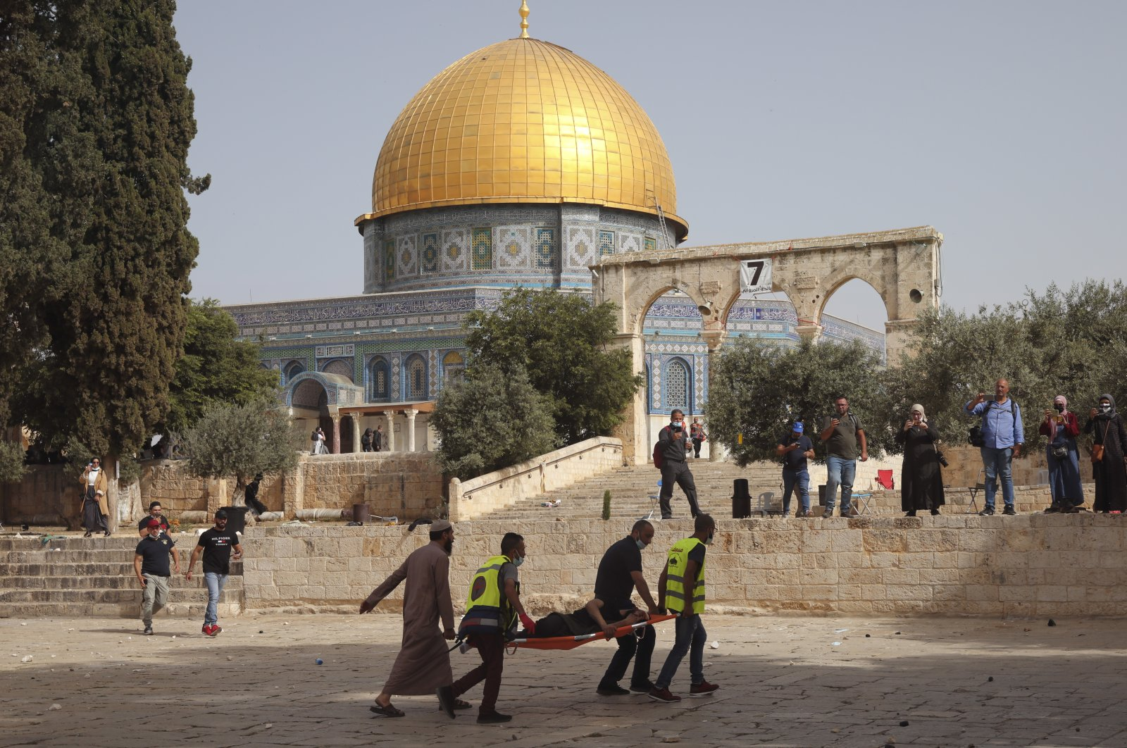 Palestinians evacuate a man wounded by Israeli forces in front of the Dome of the Rock Mosque at the Al Aqsa Mosque compound in Jerusalem's Old City, May 10, 2021. (AP Photo)