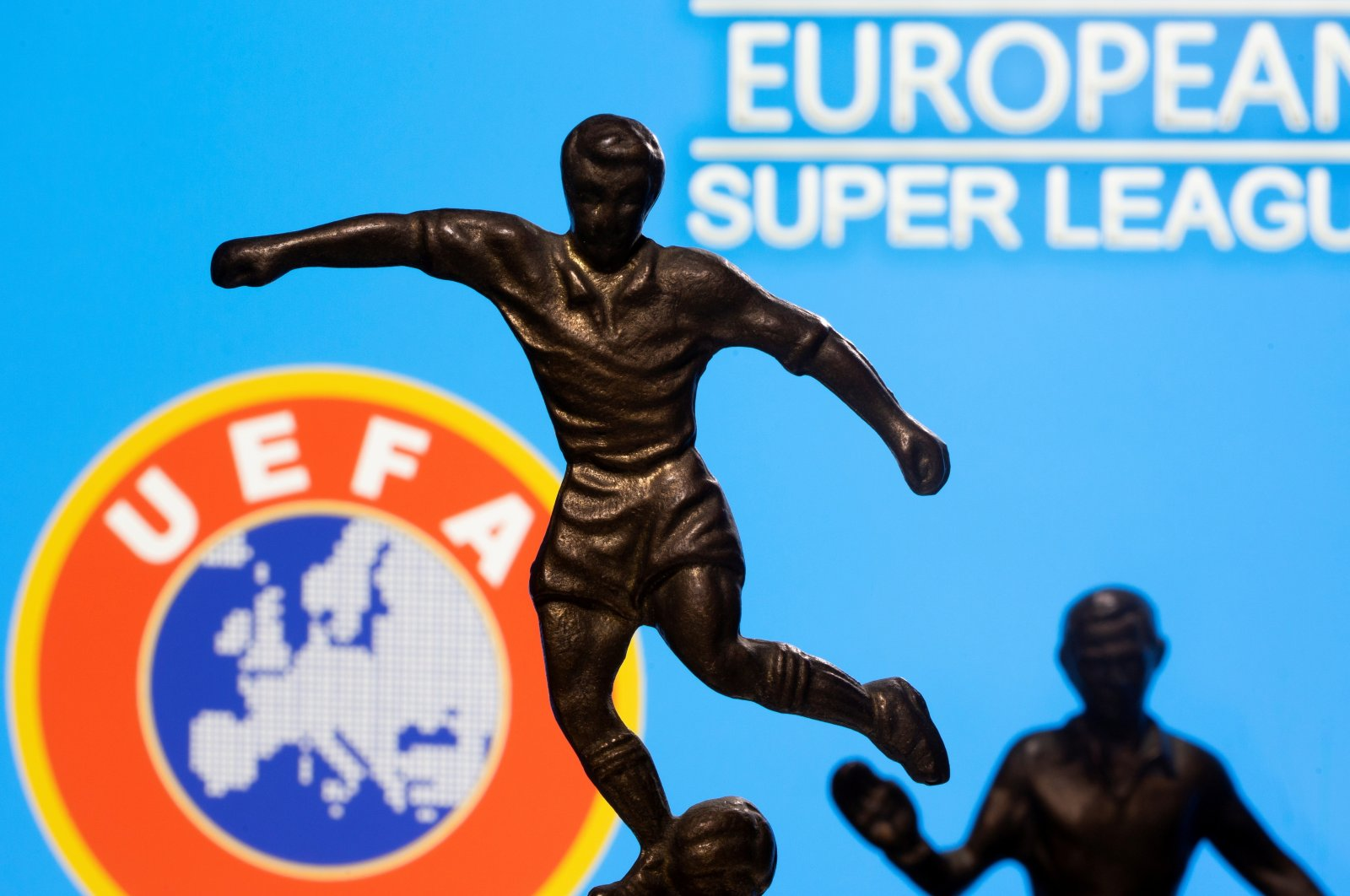 """Metal figures of football players in front of the words """"European Super League"""" and the UEFA logo are pictured in this illustration, April 20, 2021. (Reuters Photo)"""