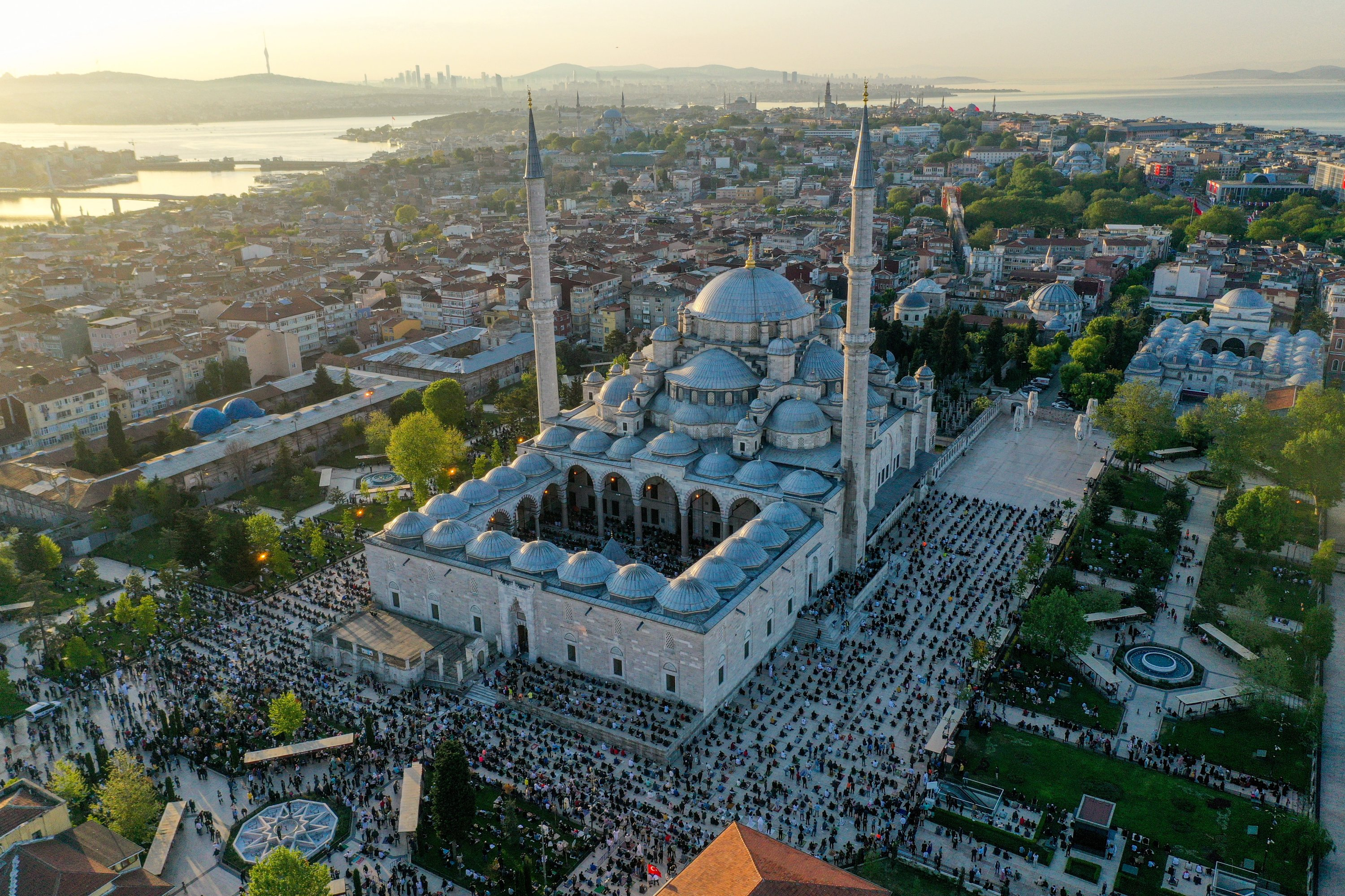 Muslim worshippers gather for the Ramadan Bayram prayers at the Fatih Mosque in Istanbul, Turkey, May 13, 2021. (AA Photo)
