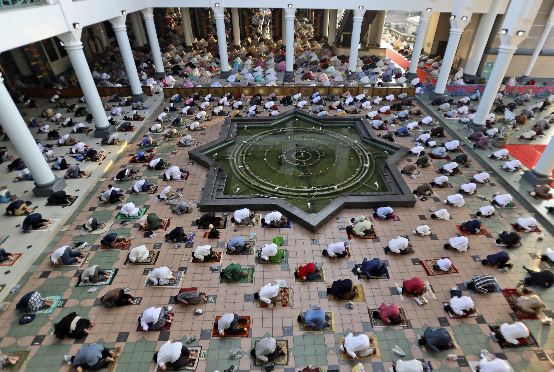 Muslims pray spaced apart to help curb the spread of coronavirus outbreak during the Ramadan Bayram prayer at Al-Akbar Mosque in Surabaya, East Java, Indonesia, May 13, 2021. (AP Photo)