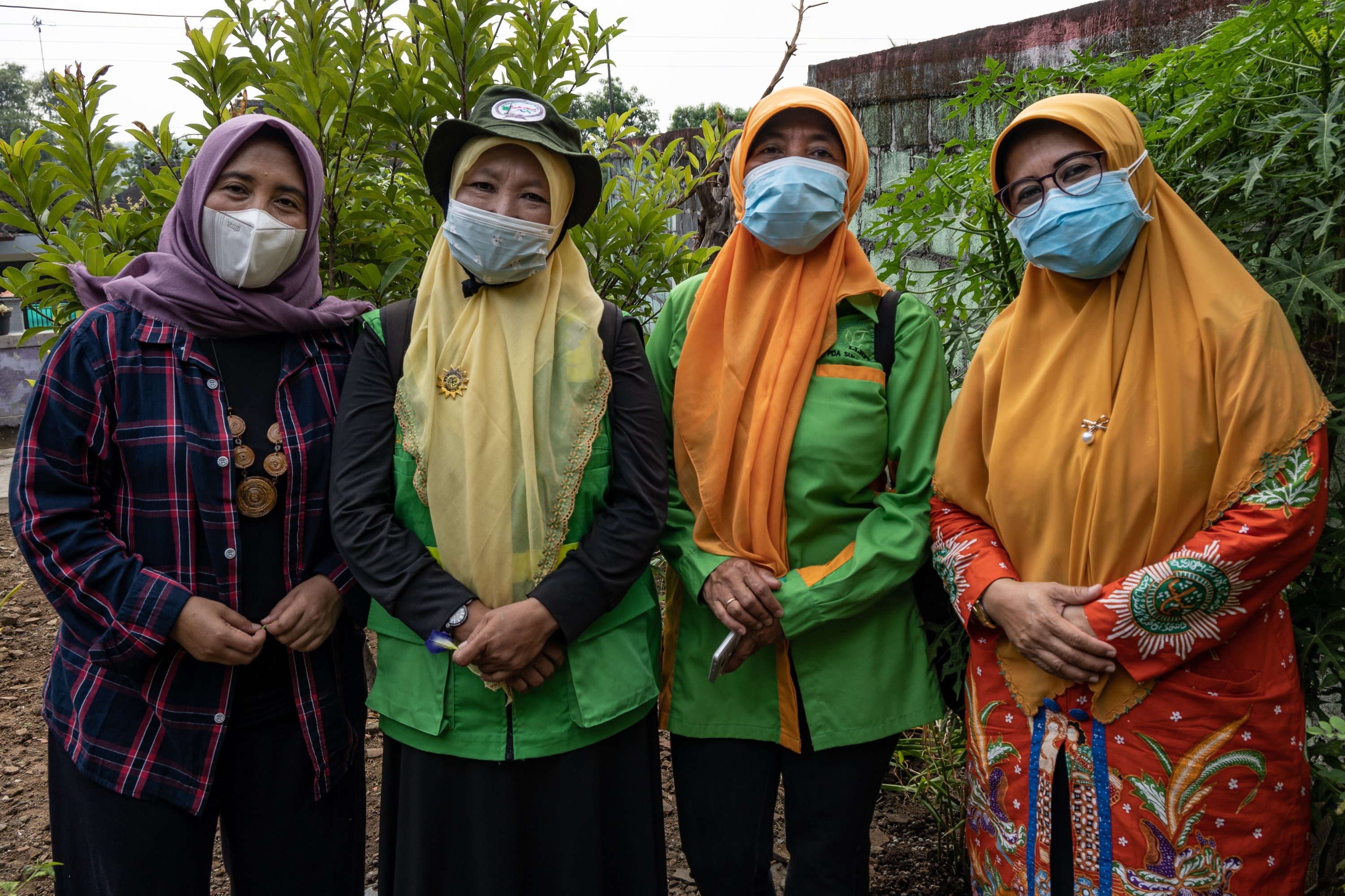 Hening Purwati Parlan (far left) the national head of 'Aisyiyah's environmental agency, together with the group's regional leaders in Sukoharjo, Central Java province, Indonesia,  May 5, 2021. (Reuters/Harry Jacques Photo)
