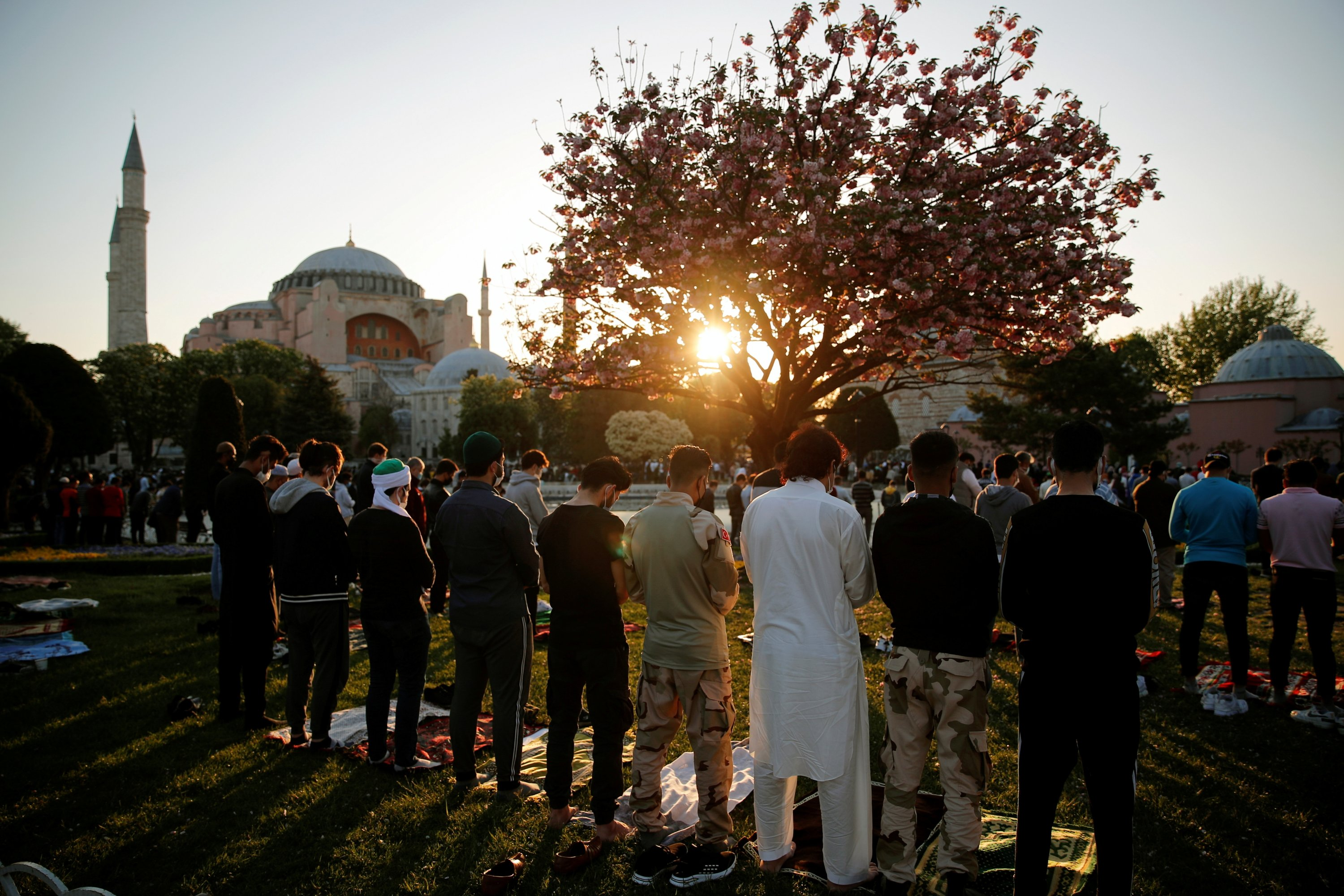 People attend Eid al-Fitr prayers marking the end of the fasting month of Ramadan, outside the Hagia Sophia Grand Mosque in Istanbul, Turkey May 13, 2021. (Reuters Photo)