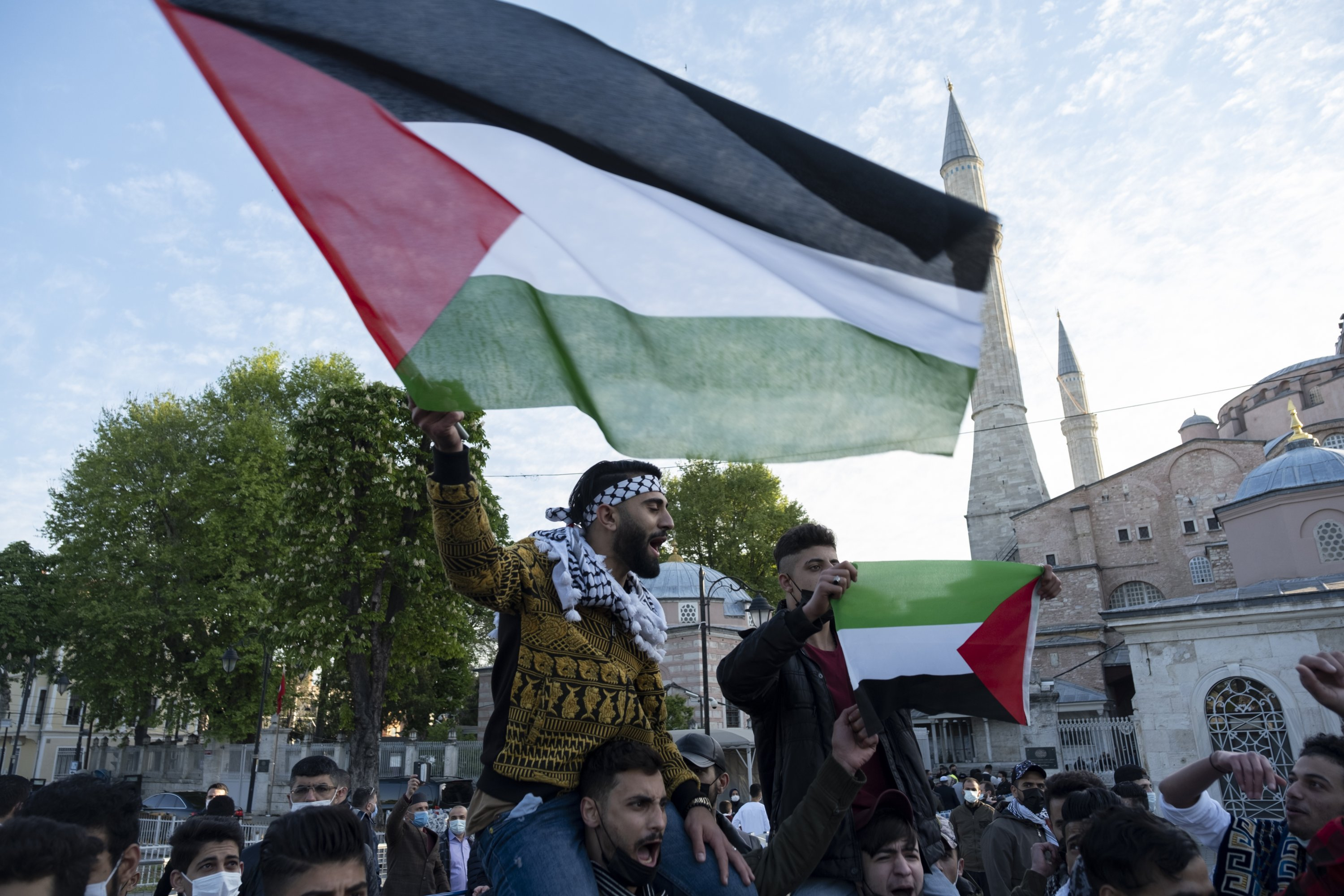 Protesters, some holding Palestinian flags chant anti-Israel slogans, during an impromptu protest in support of the Palestinians in the latest round of violence, following prayers on the first day Eid al-Fitr, which marks the end of the holy month of Ramadan, outside the Hagia Sophia Grand Mosque in the historic Sultanahmet district of Istanbul, Turkey, May 13, 2021. (AP Photo)