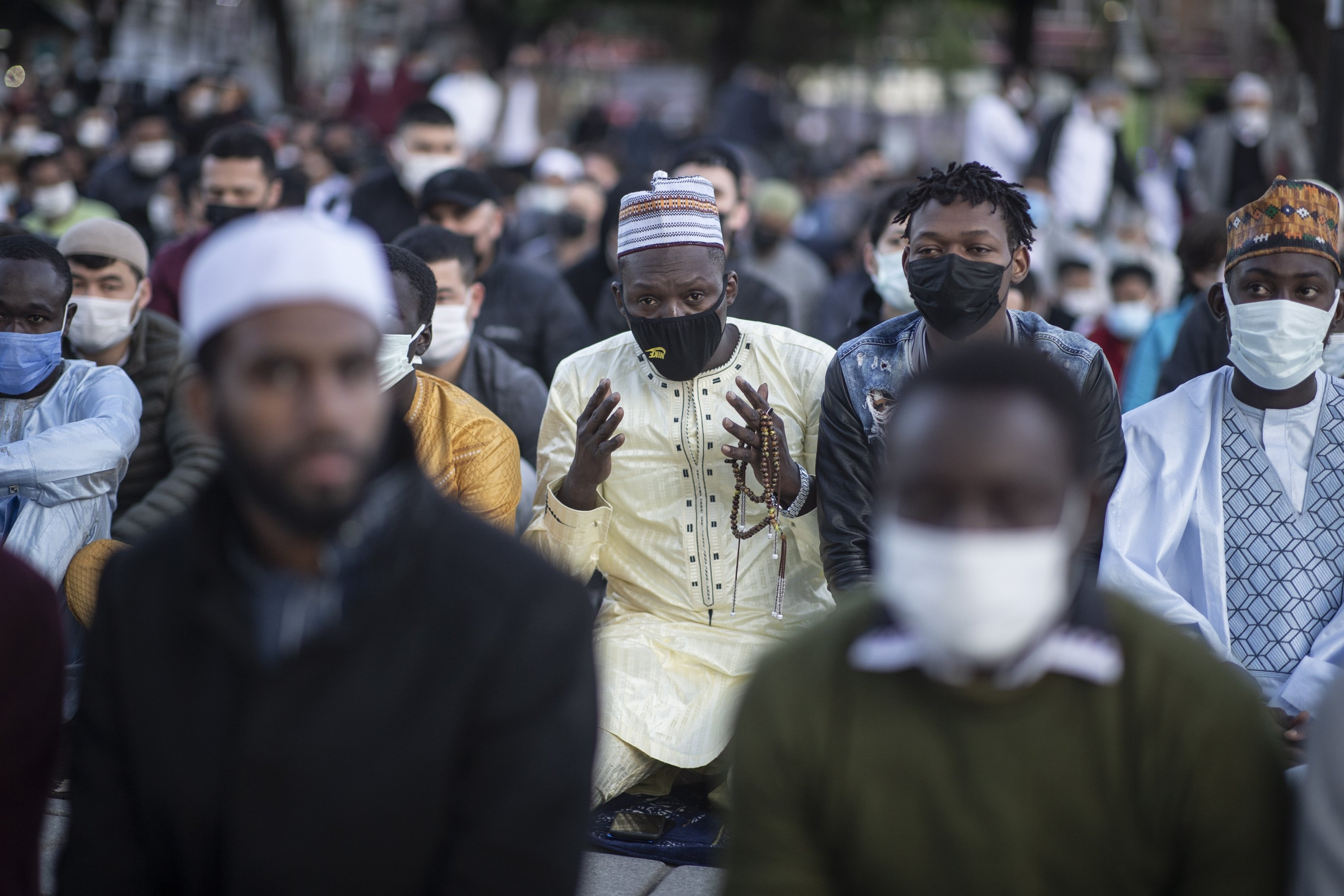 Muslims offer prayers during the first day of Eid al-Fitr, which marks the end of the holy month of Ramadan, outside the Hagia Sophia Grand Mosque in the historic Sultanahmet district of Istanbul, Turkey, May 13, 2021. (EPA Photo)