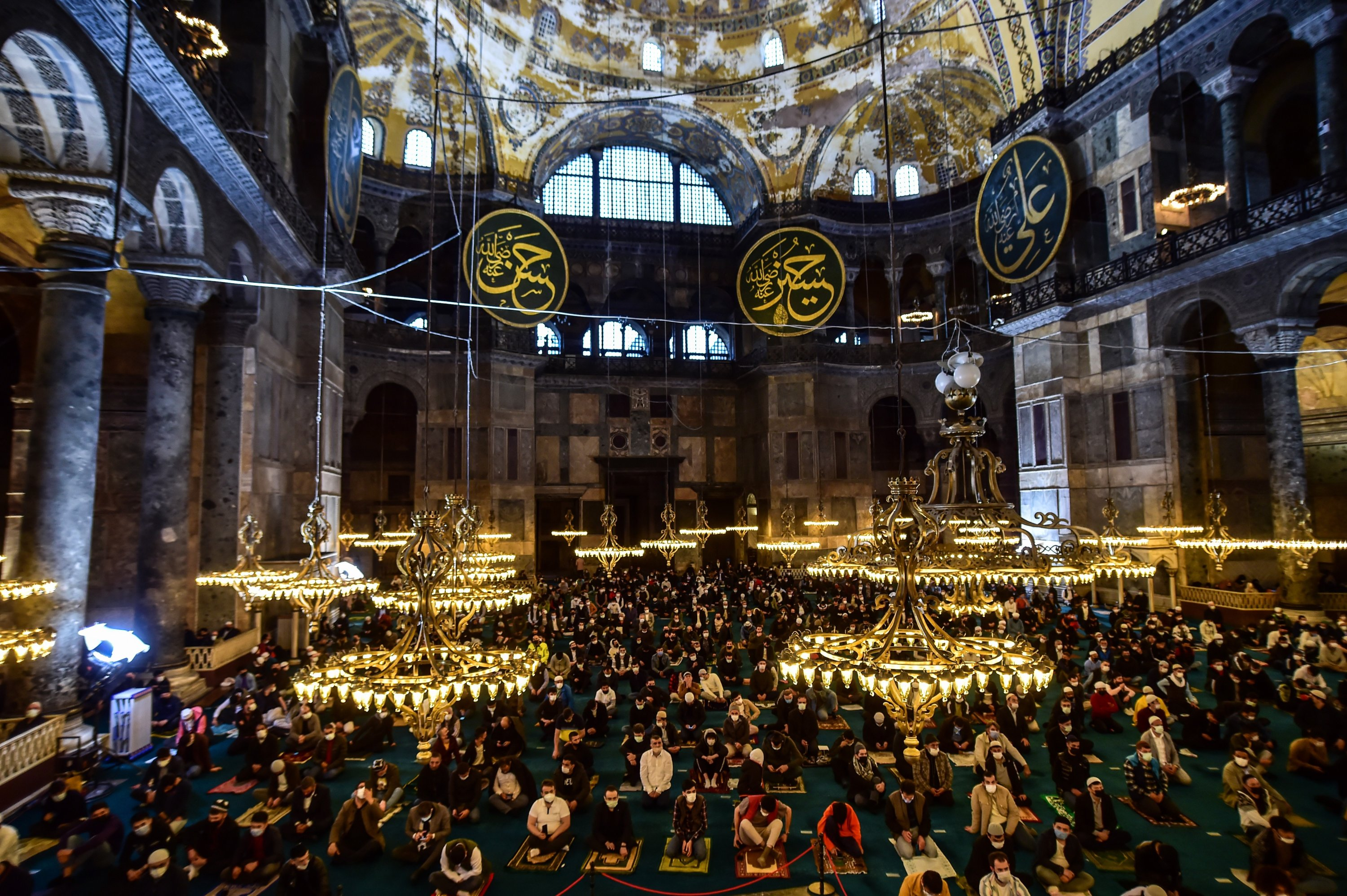Muslims offer prayers during the first day of Eid al-Fitr, which marks the end of the holy month of Ramadan, inside the Hagia Sophia Grand Mosque in the historic Sultanahmet district of Istanbul, Turkey, May 13, 2021. (IHA Photo)