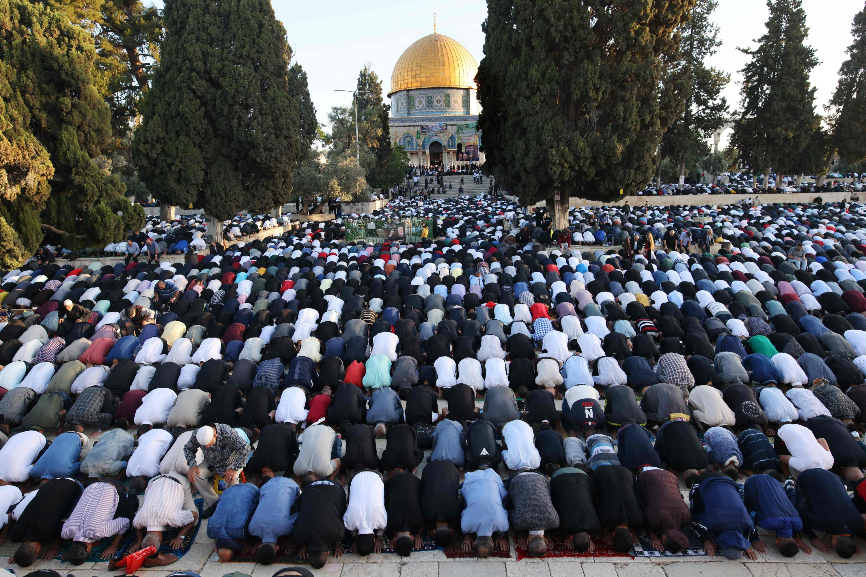 Muslims perform the morning Eid al-Fitr prayer, marking the end of the holy fasting month of Ramadan, outside the Dome of the Rock in the Al-Aqsa Mosque complex, East Jerusalem, occupied Palestine, May 13, 2021. (AFP Photo)