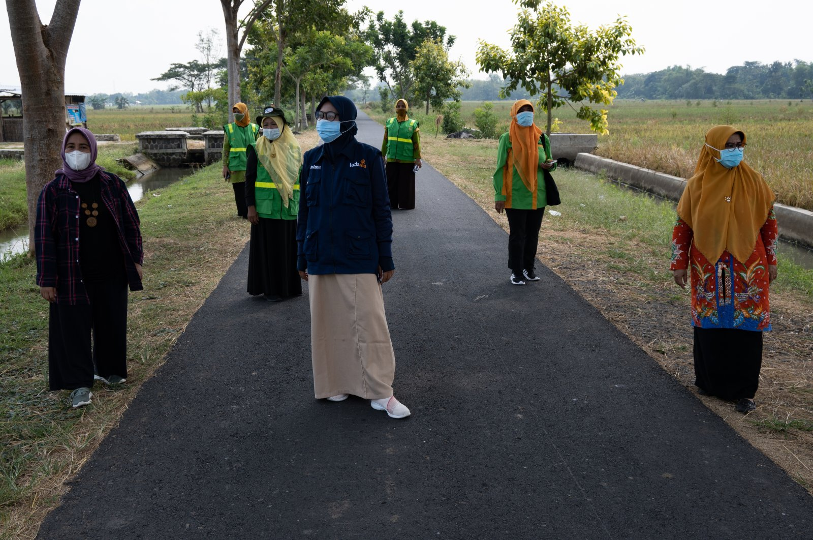 National and regional leaders of 'Aisyiyah's environmental chapter stand between trees the group planted in Sukoharjo, Central Java province, Indonesia on May 5, 2021.(Reuters/Harry Jacques Photo)