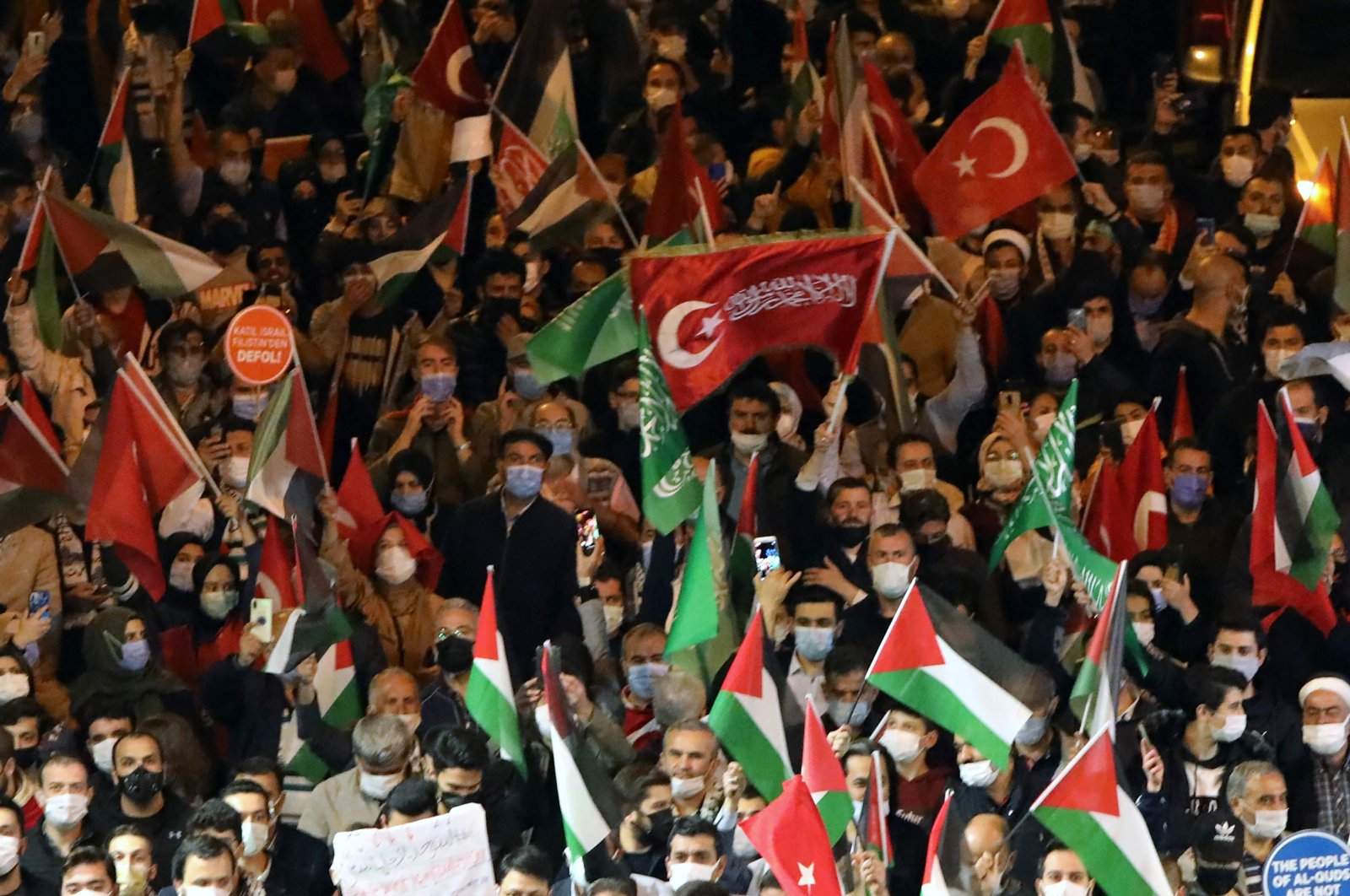 This file photo shows protesters holding Palestine and Turkish national flags and chant slogans during a demonstration outside the Israel Consulate General in Istanbul, Turkey, late on May 10, 2021. (AFP Photo)