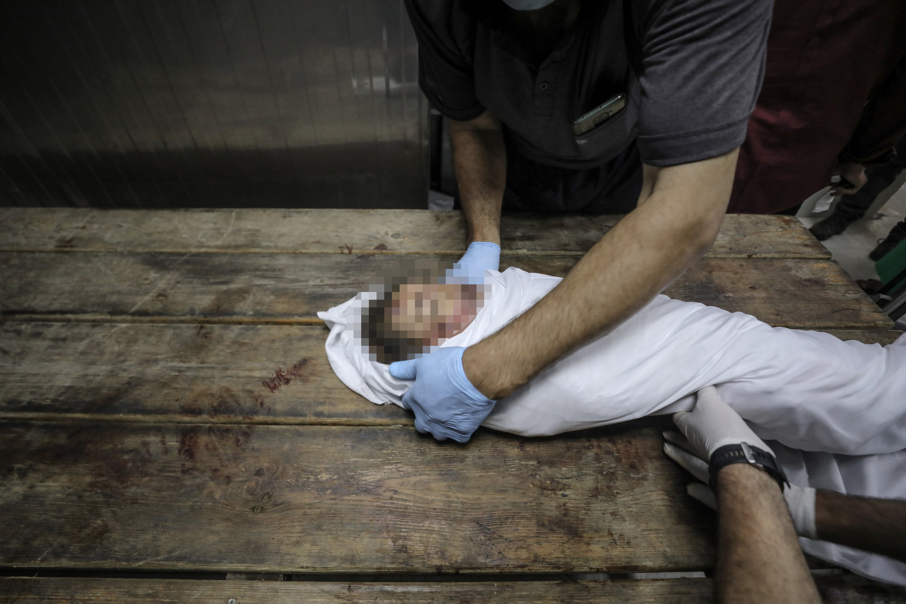 A deceased toddler from the Al-Tanani family, killed in an Israeli airstrike, is seen inside the morgue of the Indonesian Hospital, Gaza Strip, Palestine, May 14, 2021. (AA Photo)