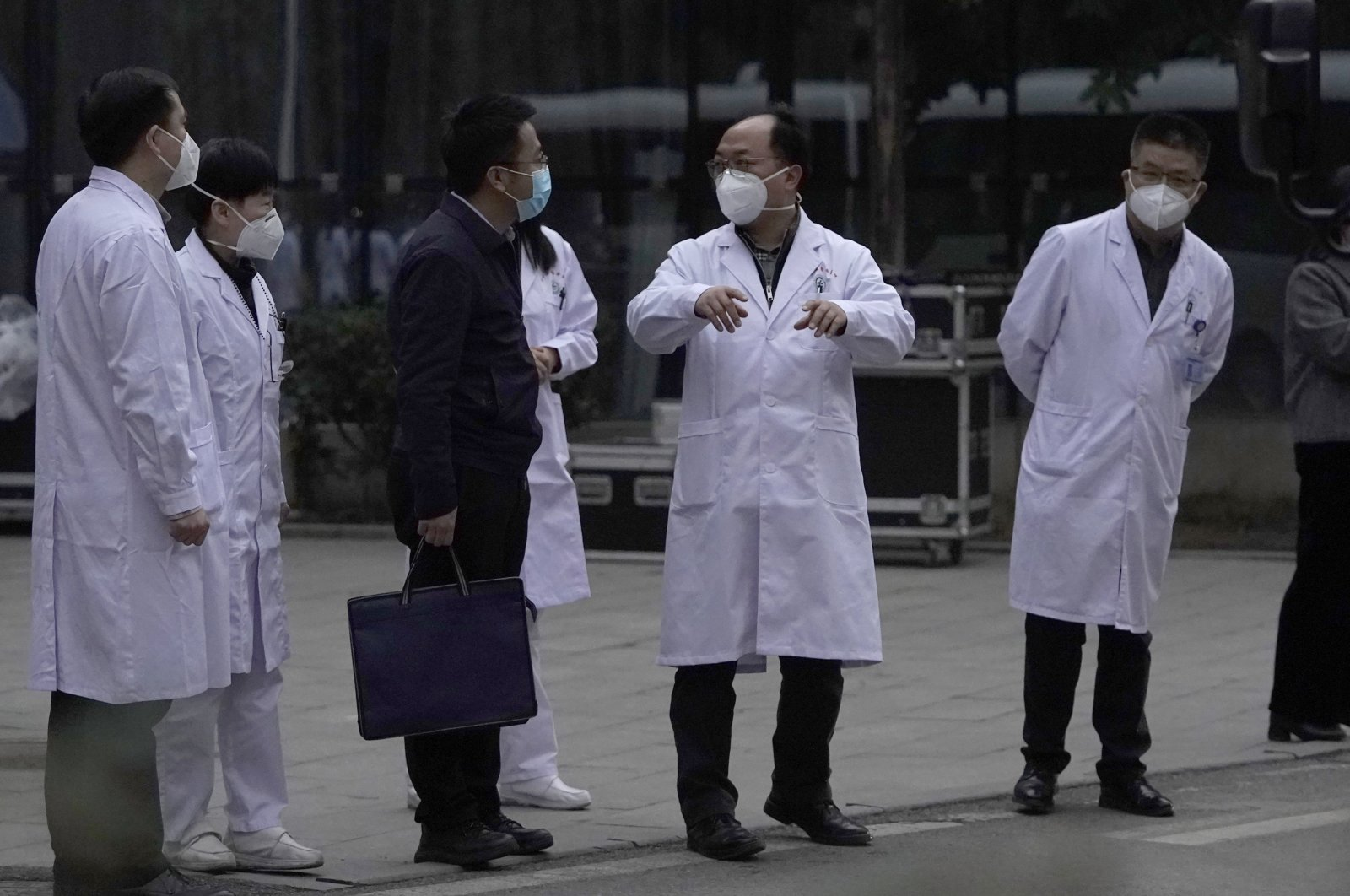 Chinese medical staff react as the World Health Organization (WHO) team leave after their visit to the Hubei Provincial Hospital of Integrated Chinese and Western Medicine, in Wuhan, China, Jan. 29, 2021. (AP Photo)