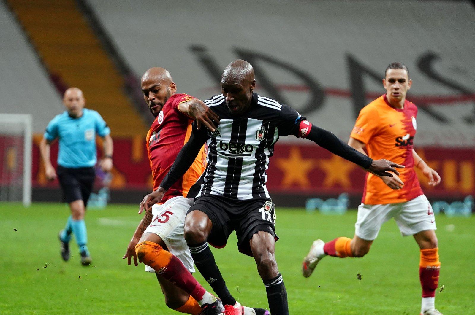 Galatasaray's Marcao (L) and Beşiktaş's Atiba Hutchinson compete for the ball during a Turkish Süper Lig match at Türk Telekom Arena in Istanbul, Turkey, May 8, 2021. (IHA Photo)