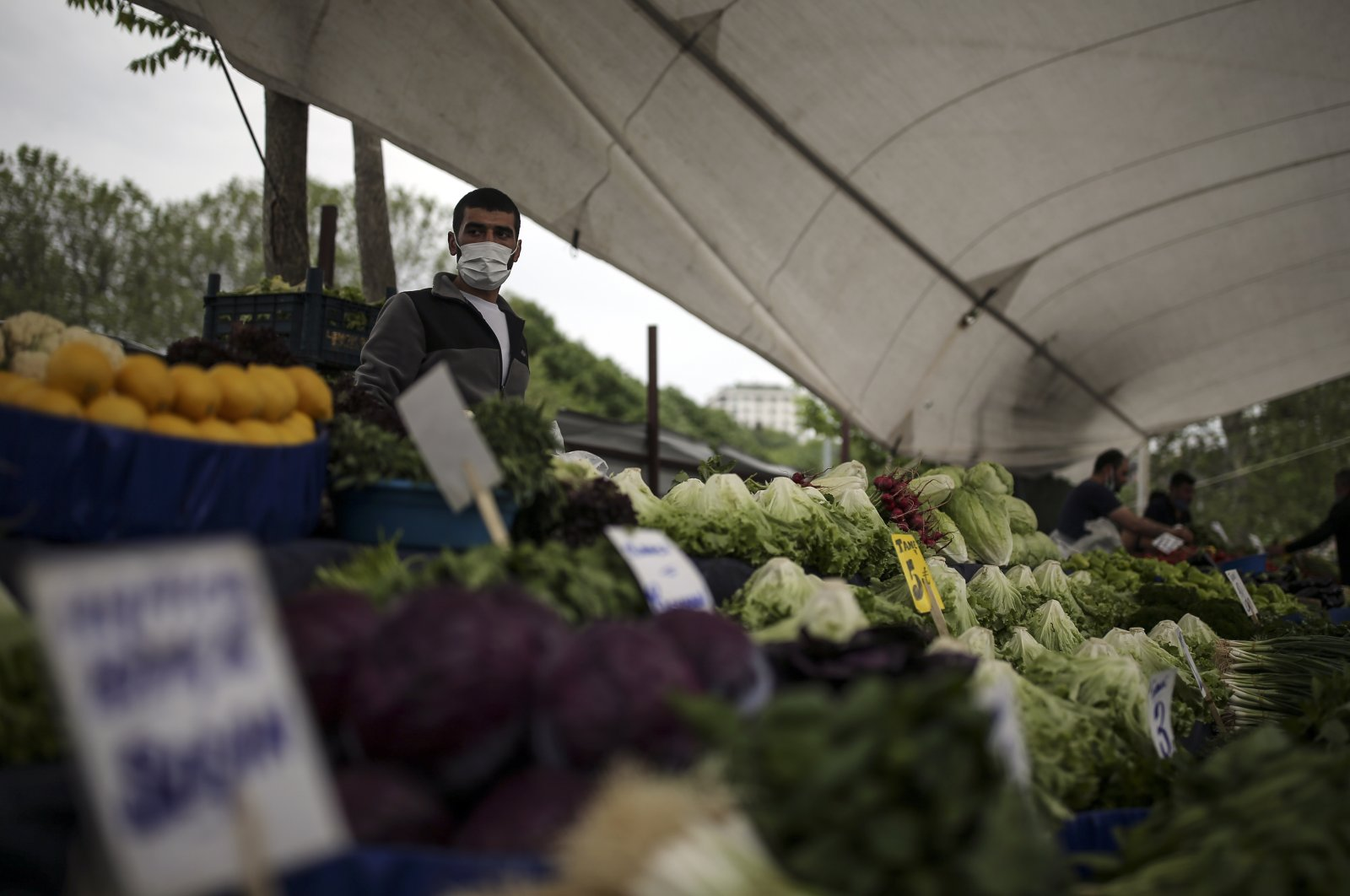 People shop in a market in Istanbul, Saturday, May 8, 2021, after they were allowed to open during the total lockdown. (AP Photo)
