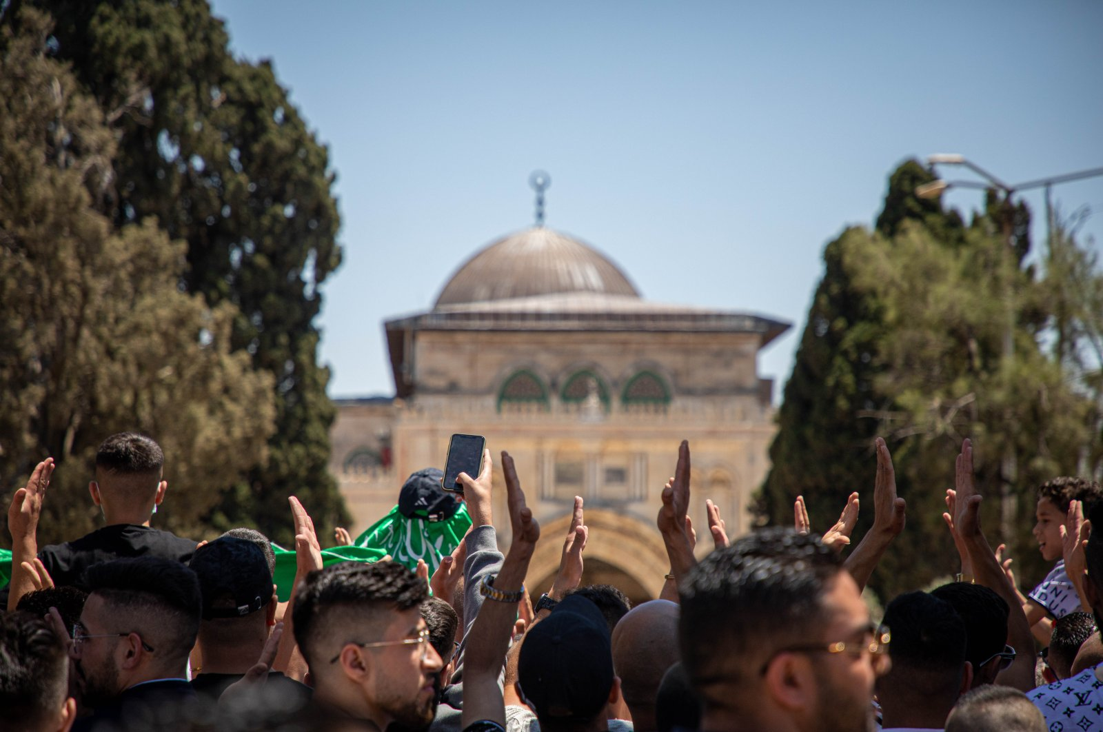 Palestinian Muslim worshippers chant slogans calling on military support from Turkey following Friday prayers in Jerusalem's al-Aqsa mosque compound, the third holiest site of Islam, on May 14, 2021. (AA Photo)