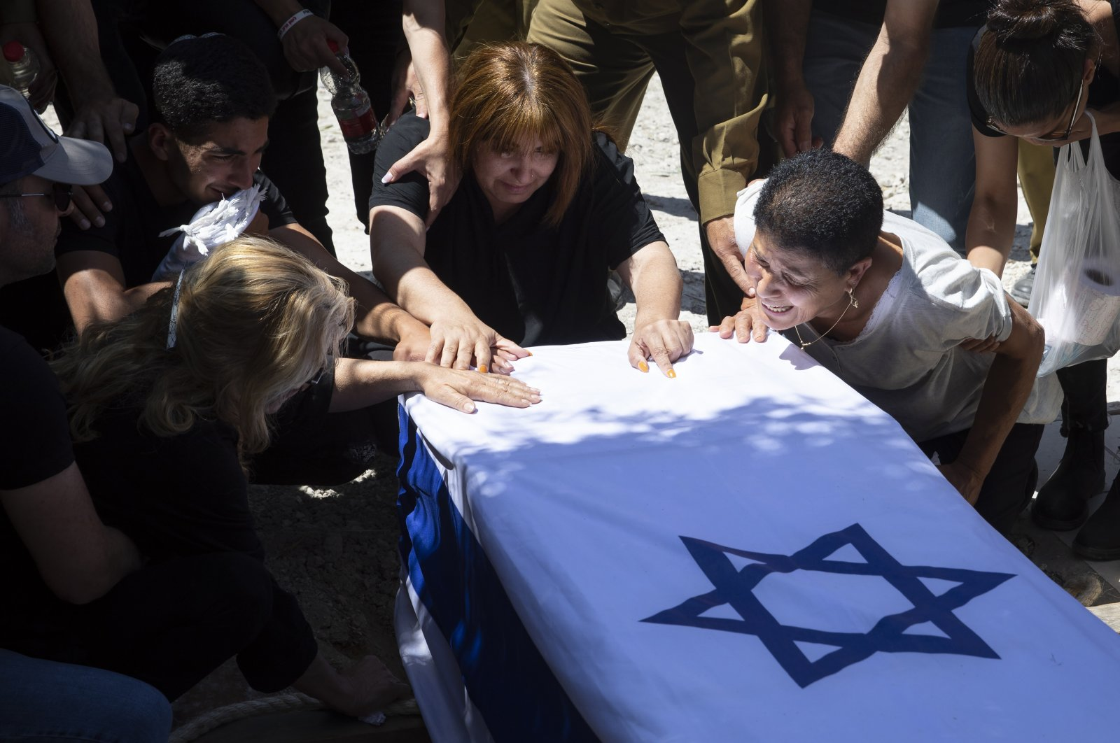Relatives of Israeli soldier Omer Tabib, 21, mourn during his funeral at the cemetery in the northern Israeli town of Elyakim, Thursday, May 13, 2021. (AP Photo)
