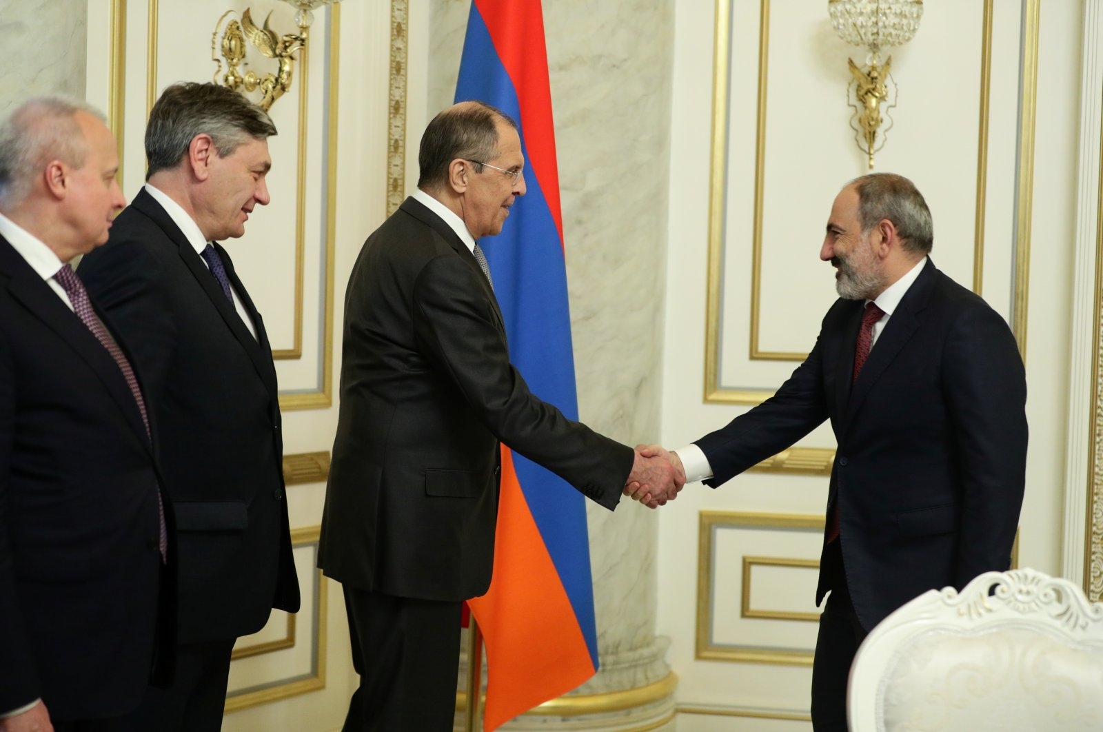 Russia's Foreign Minister Sergey Lavrov shakes hands with Armenia's acting Prime Minister Nikol Pashinian during a meeting in Yerevan, Armenia, May 6, 2021. (Russian Foreign Ministry handout via Reuters)