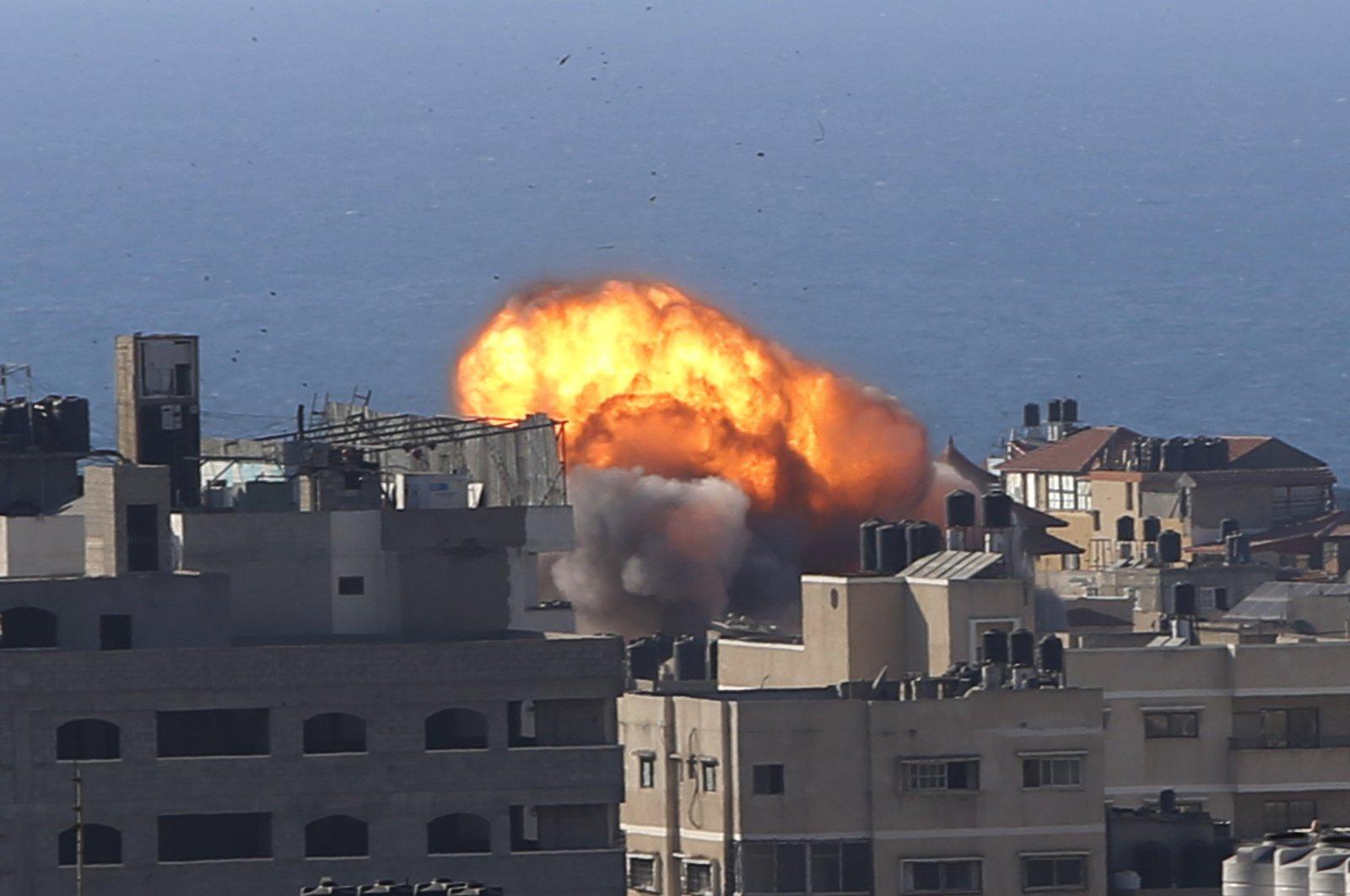 Smoke rises following Israeli airstrikes on a building in Gaza City, Palestine, Friday, May 14, 2021. (AP Photo)