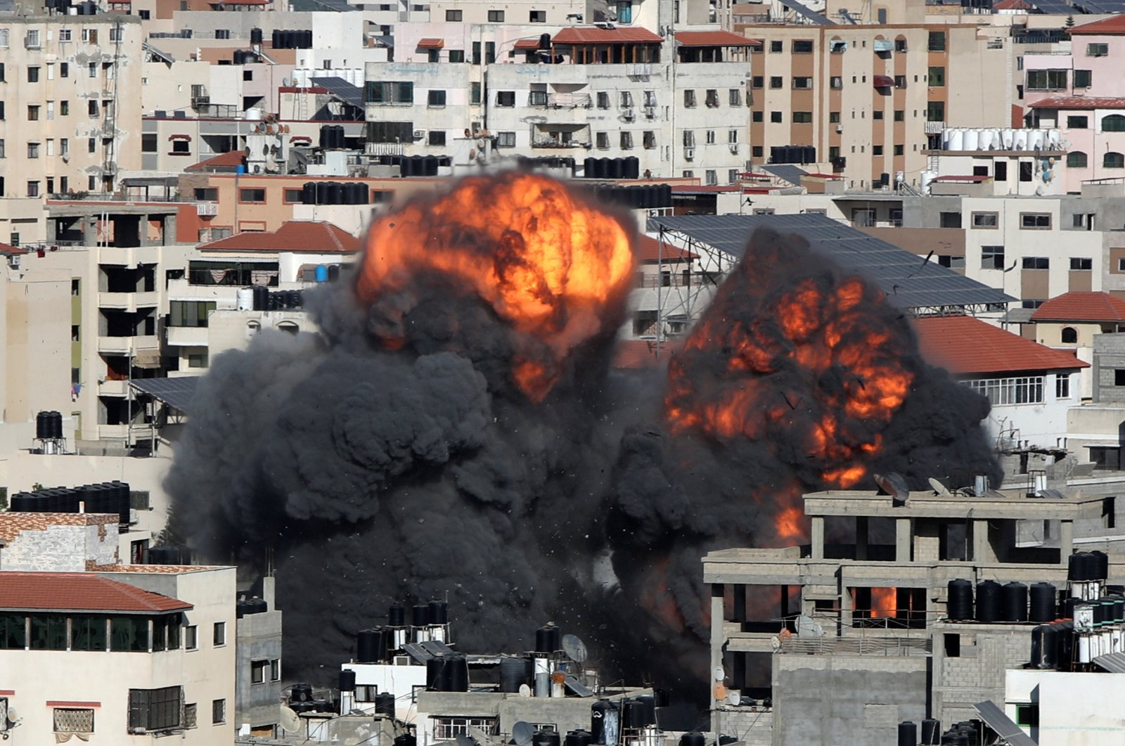 Smoke and flames rise during an Israeli airstrike on Gaza City, Palestine, May 14, 2021. (Reuters Photo)