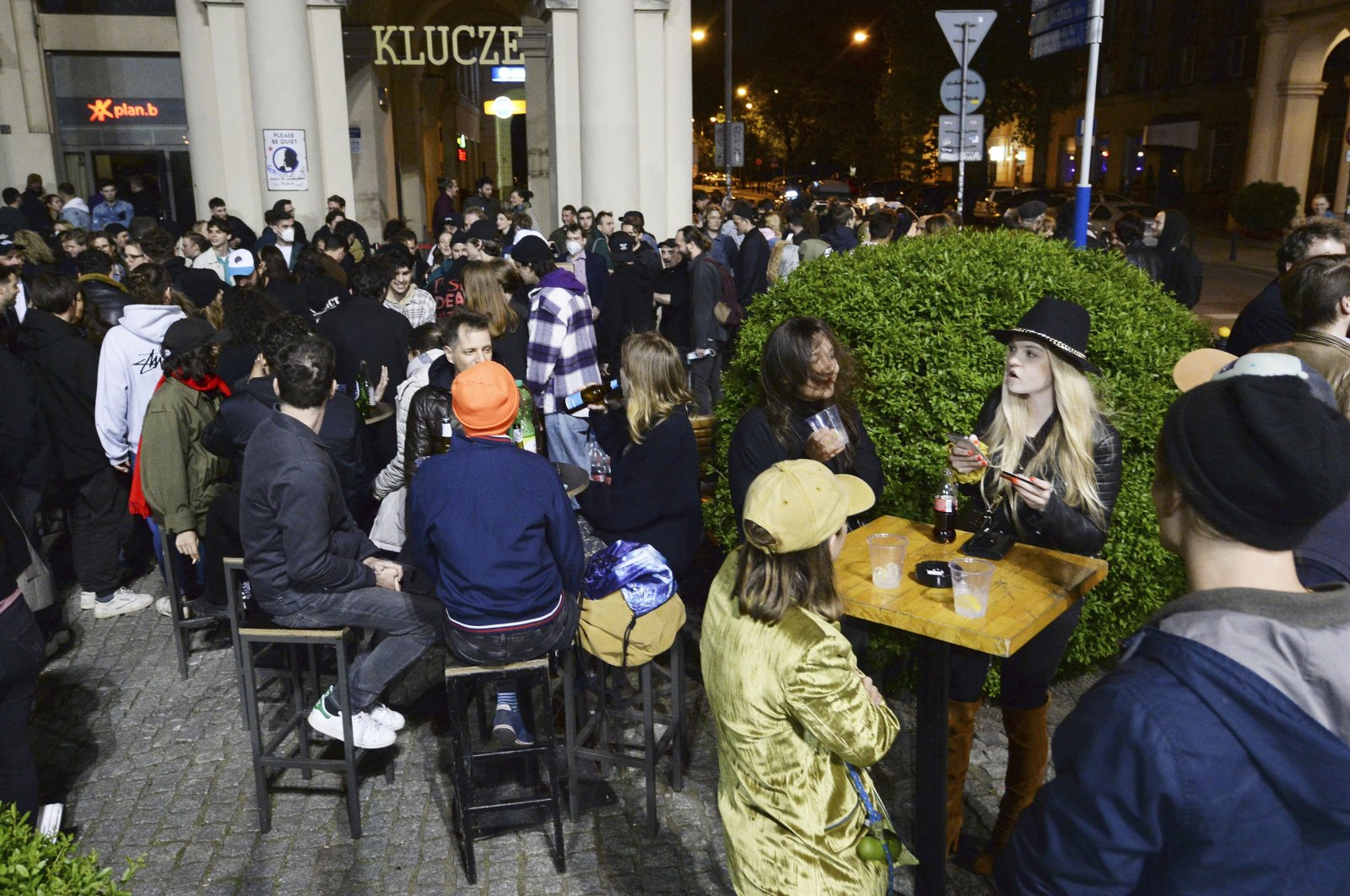 People gather and celebrate as bars, clubs and other establishments reopened in Poland after being closed for seven months, in Warsaw, Poland, May 14, 2021. (AP Photo)