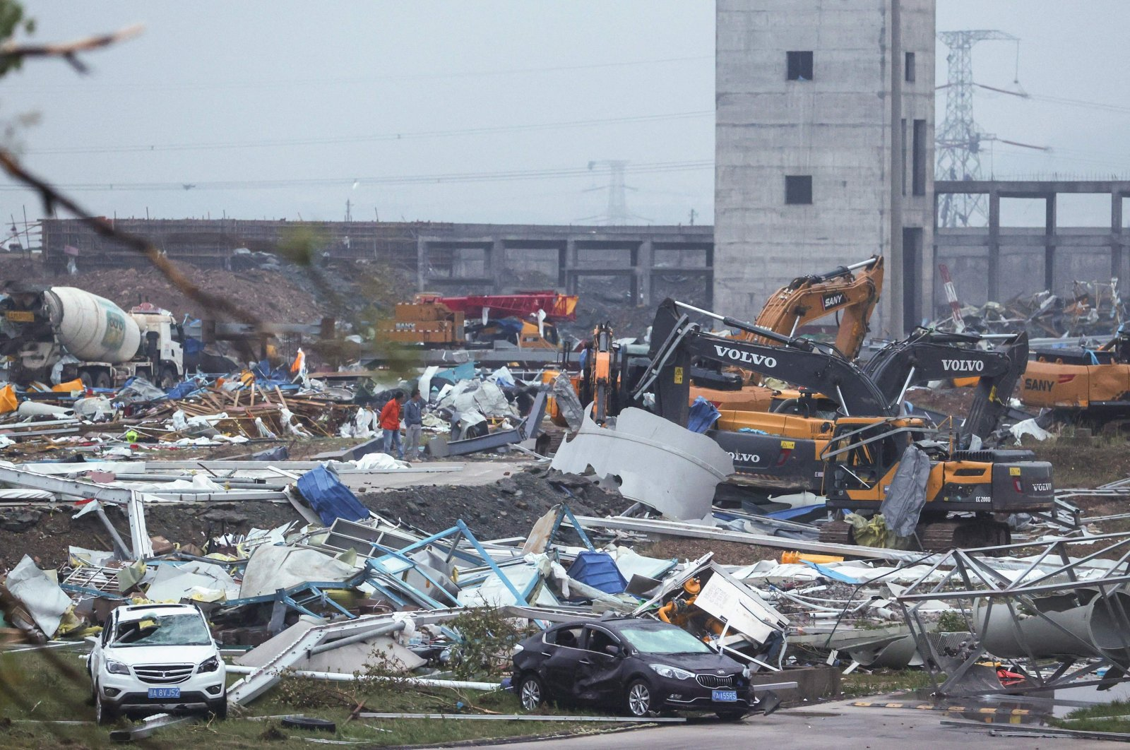 Damaged vehicles and debris are pictured at a construction site after a tornado hit an economic zone in Wuhan, central Hubei province, China, May 15, 2021. (AFP Photo)