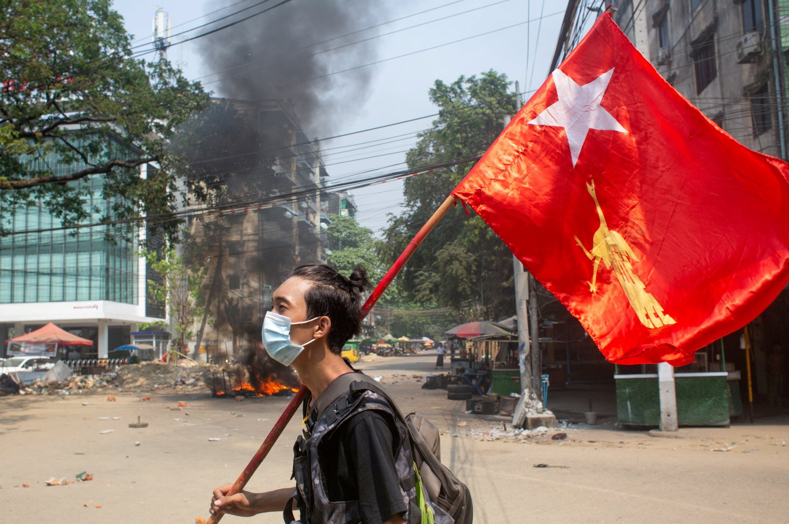 A man holds a National League for Democracy (NLD) flag during a protest against the military coup, in Yangon, Myanmar, March 27, 2021. (Reuters Photo)