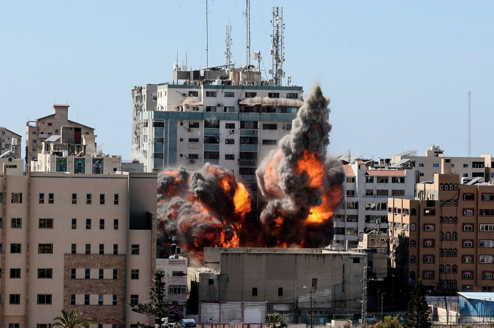 A ball of fire erupts from the Jala Tower as it is destroyed in an Israeli airstrike in Gaza City, Palestine, May 15, 2021. (AFP Photo)
