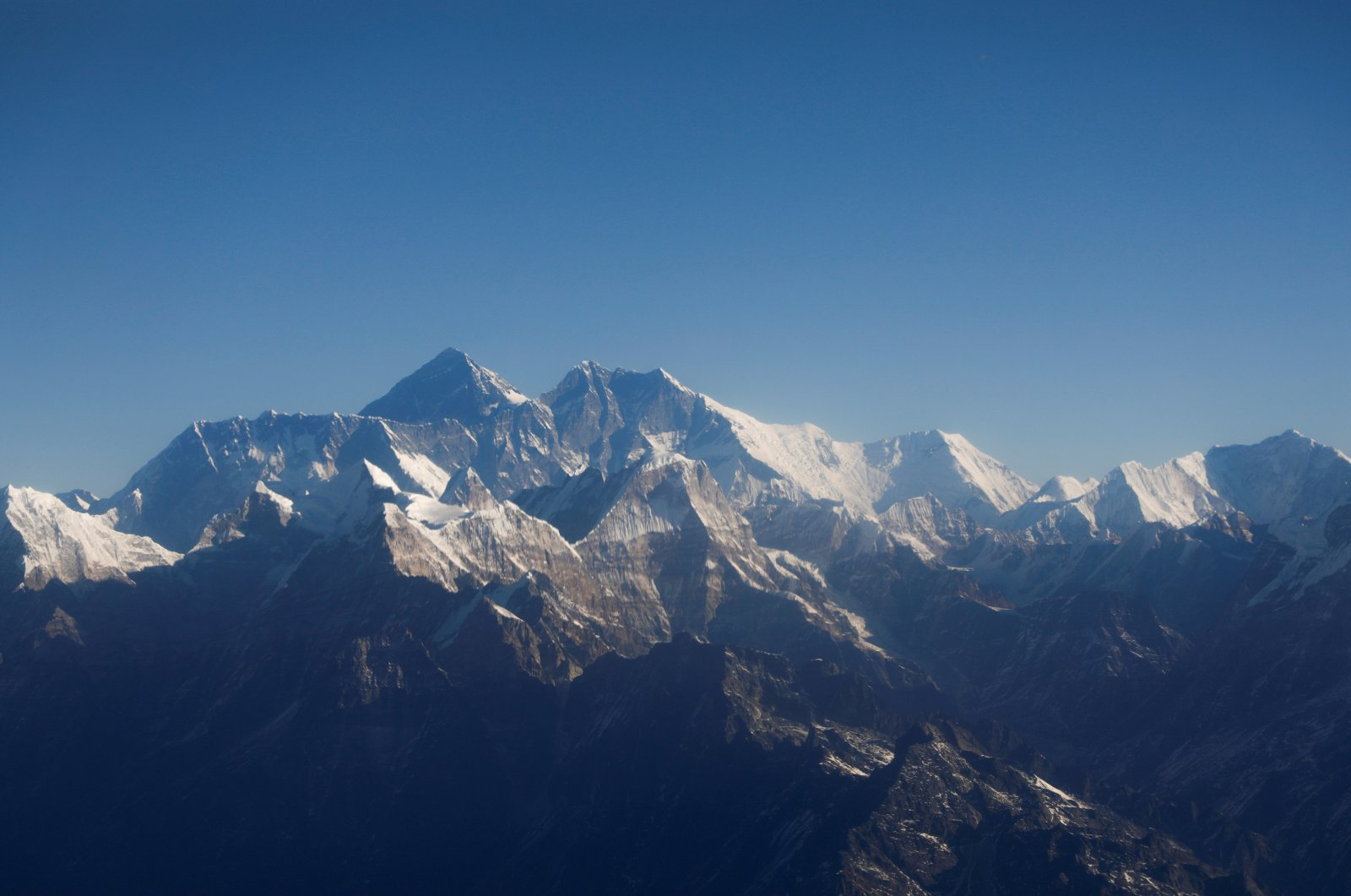 Mount Everest, the world highest peak, and other peaks of the Himalayan range are seen through an aircraft window during a mountain flight from Kathmandu, Nepal, Jan. 15, 2020. (Reuters Photo)