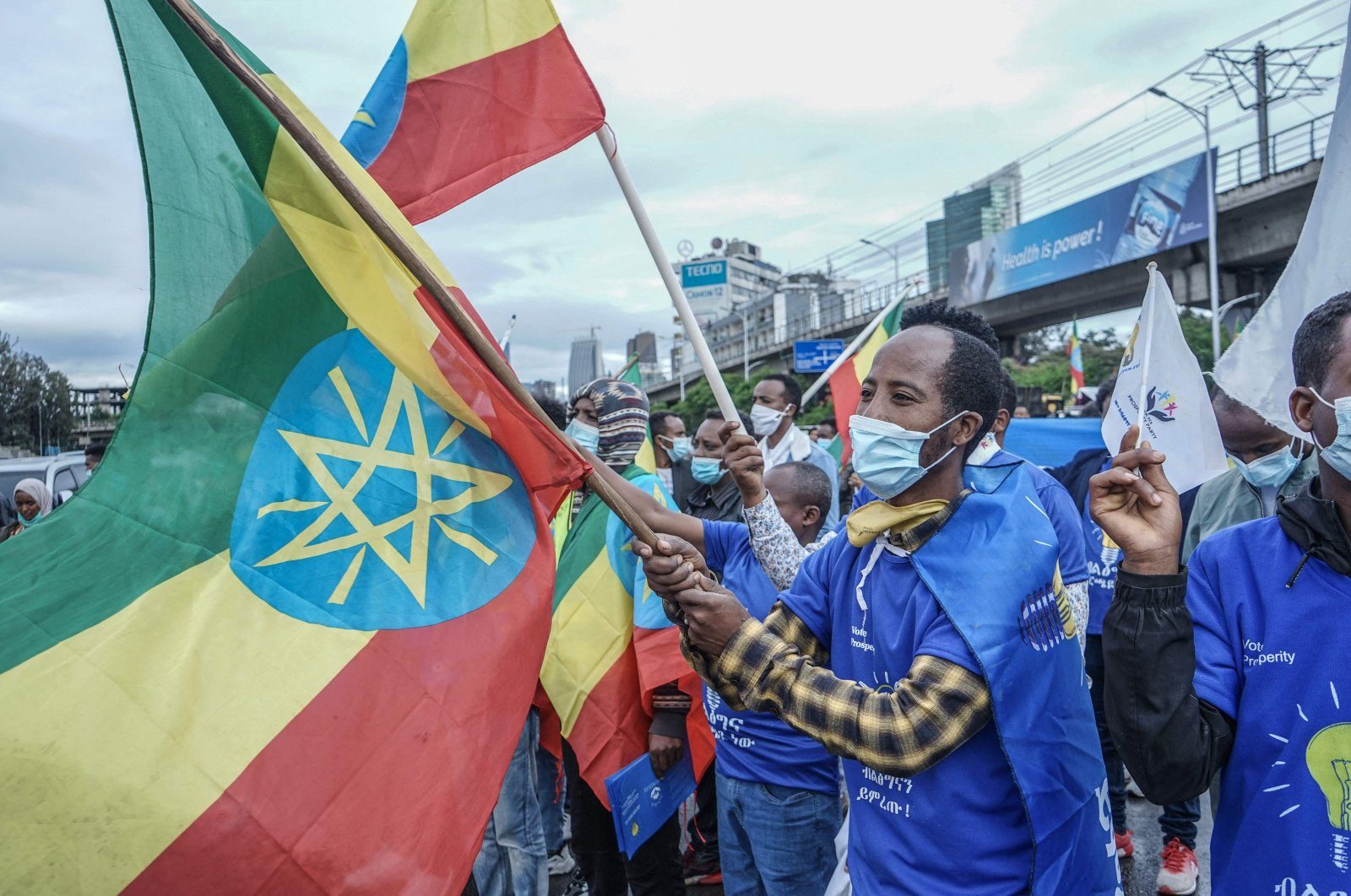 A Supporter of the Prosperity Party waves Ethiopia's national flag during the electoral campaign rally for the general elections in Addis Ababa, Ethiopia, on May 7, 2021. (AFP Photo)