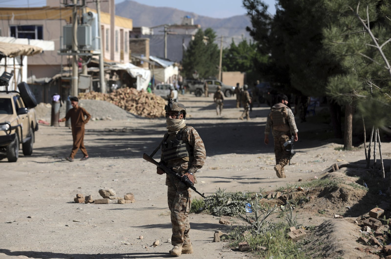 Afghan security personnel arrive at the site of a bomb explosion in Shakar Dara district of Kabul, Afghanistan, May 14, 2021. (AP Photo)
