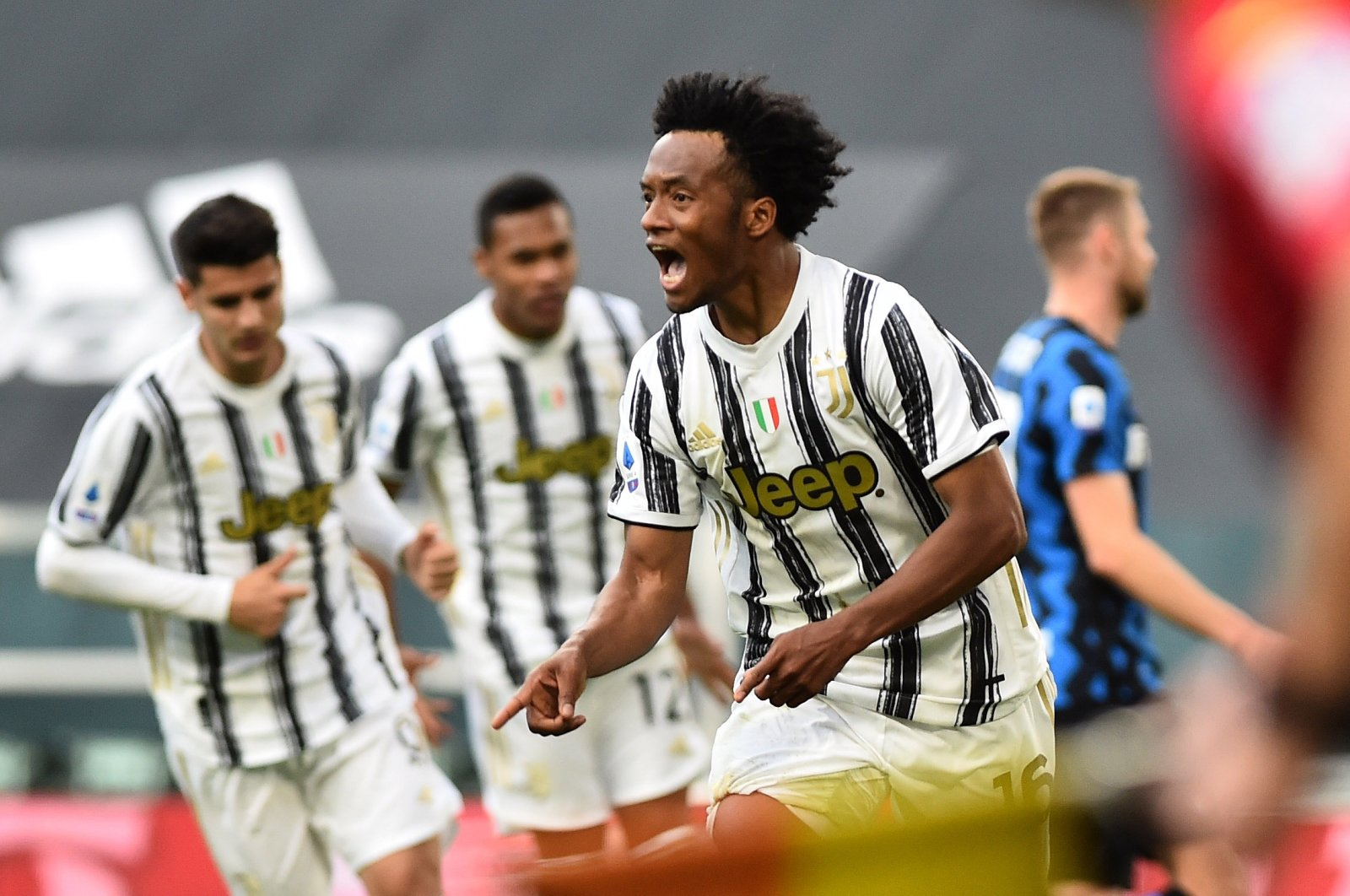 Juventus midfielder Juan Cuadrado celebrates scoring his team's third goal during Serie A match Week 37 match against Inter Milan, at Allianz Stadium, Turin, Italy, May 15, 2021. (Reuters Photo)