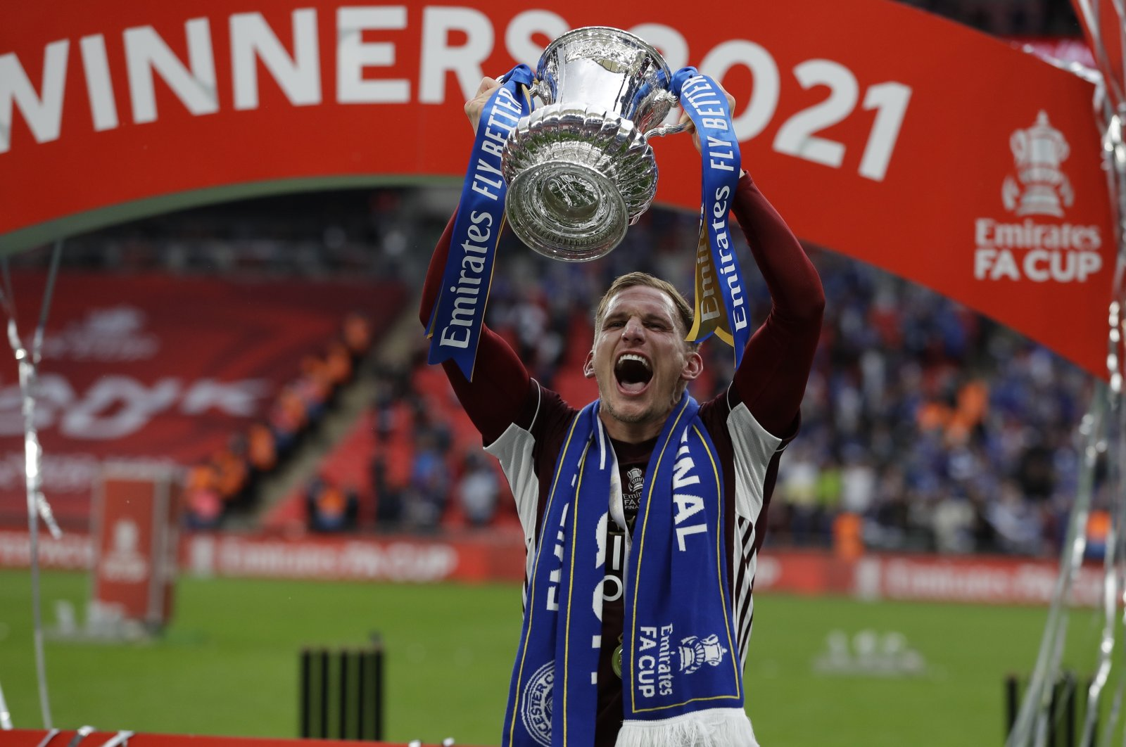 Leicester's Marc Albrighton celebrates with the trophy after winning the English FA Cup final between Chelsea FC and Leicester City at the Wembley Stadium in London, Britain, May 15, 2021. (EPA Photo)