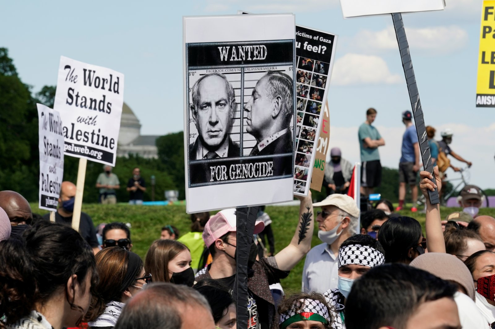 A pro-Palestinian demonstrator holds a placard with a photograph of Israeli Prime Minister Benjamin Netanyahu during a rally at the Washington Monument in Washington, U.S., May 15, 2021. (Reuters Photo)