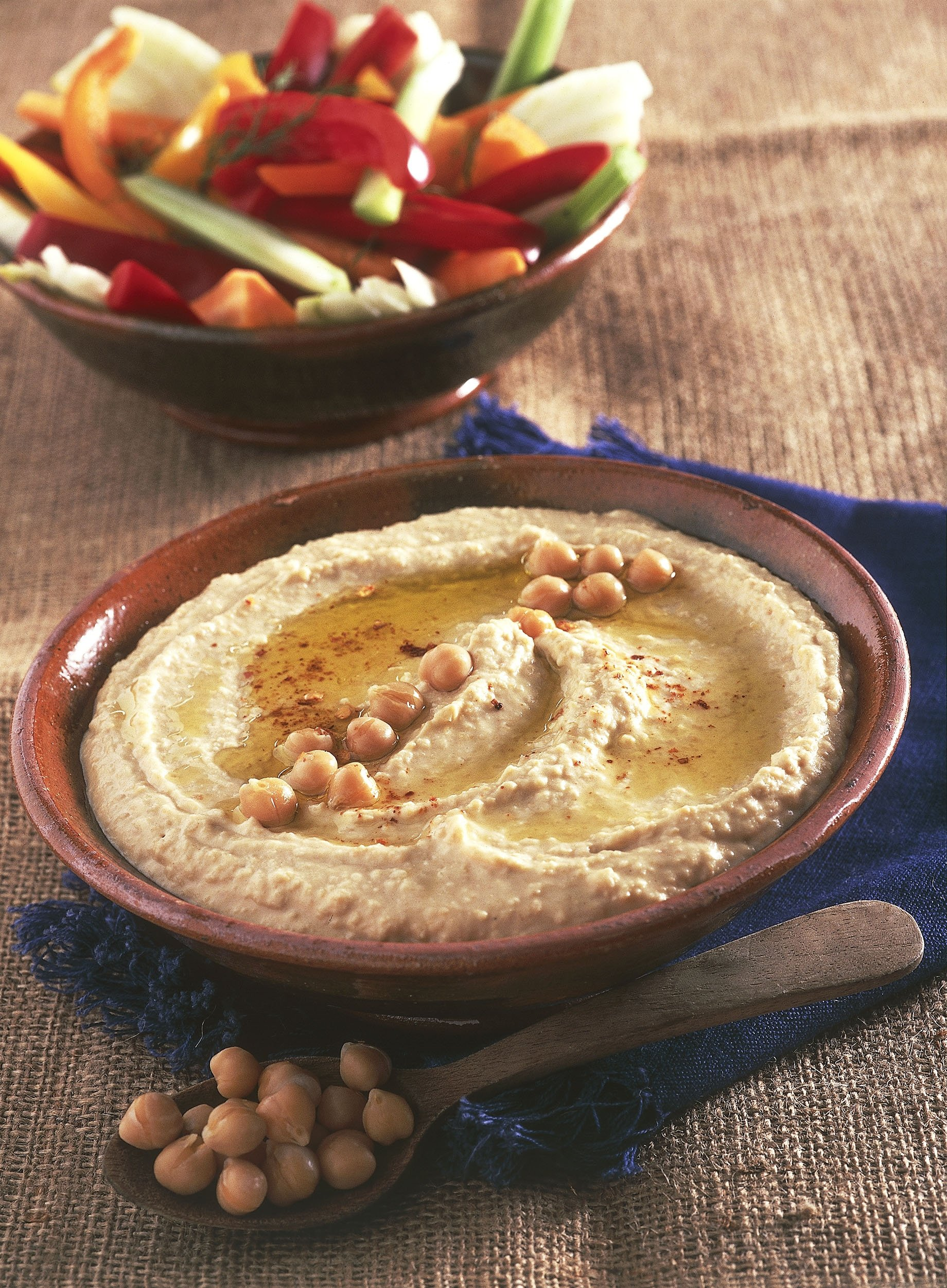 Hummus is a typical dip in Middle Eastern cuisine but is now popular workdwide. (Photo by DeAgostini/Getty Images)