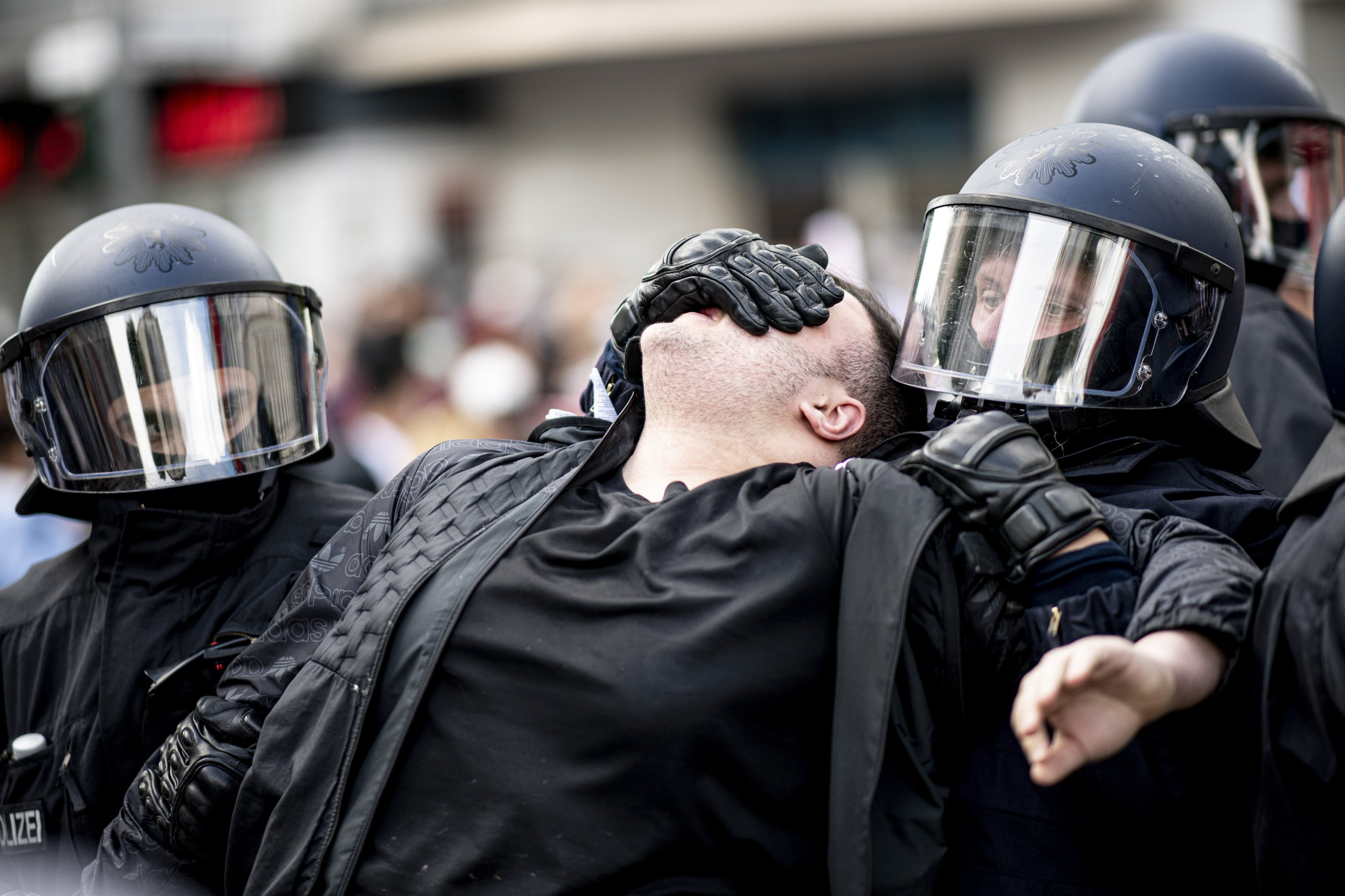 Police officers detain a participant in a Palestinian groups' rally against Israeli violence, in Neukoelln, Berlin, Germany, May 15, 2021. (AP Photo)