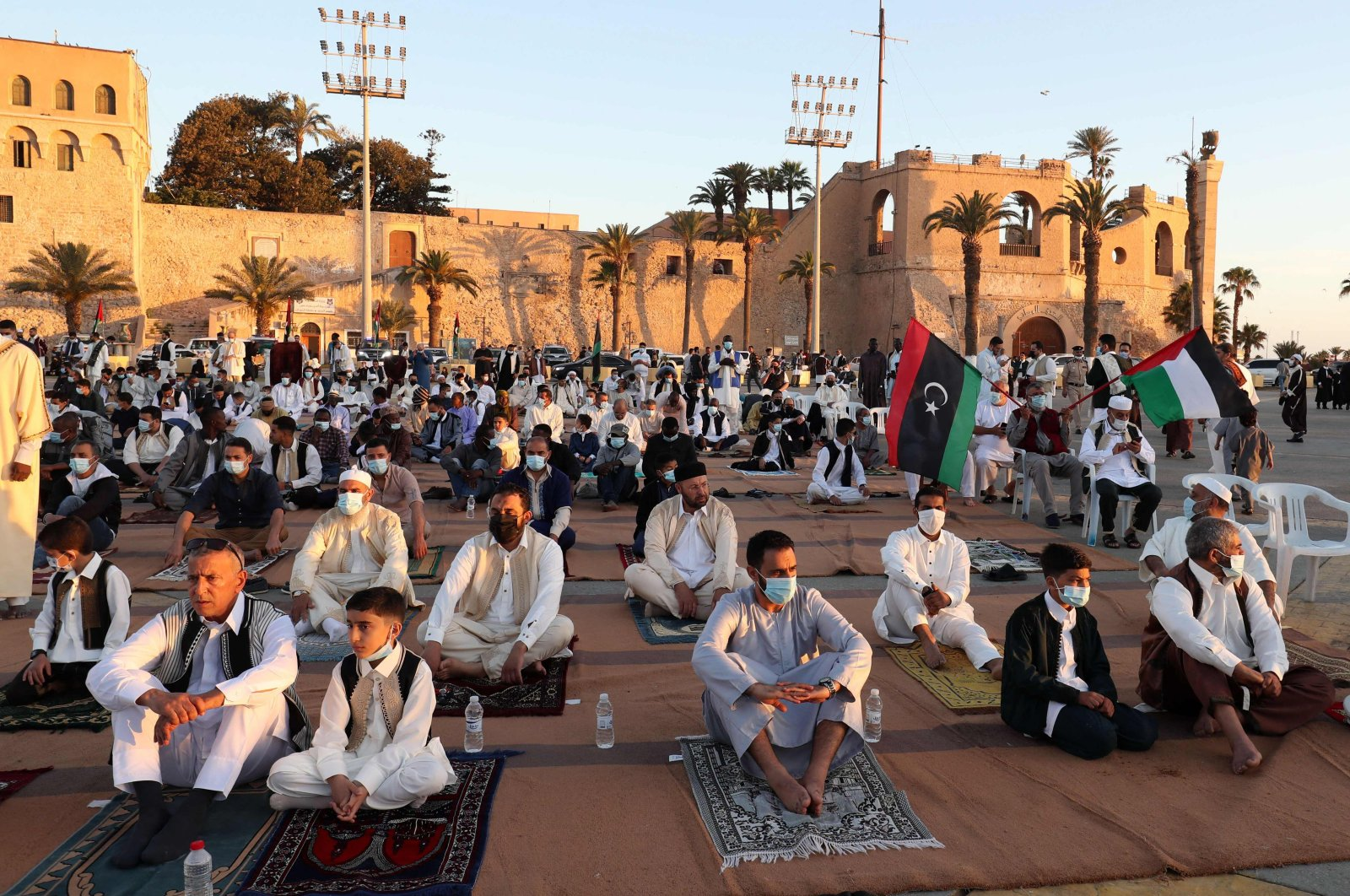 Libyan Muslim worshippers gather to perform the Eid al-Fitr prayers at Martyrs Square marking the end of the holy fasting month of Ramadan, at the capital Tripoli, Libya, May 13, 2021. (Photo by Mahmud Turkia via AFP)