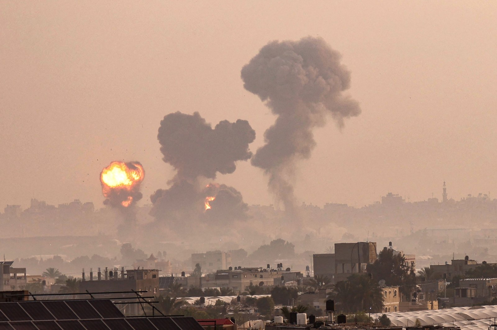 Fire and smoke billow from Israeli airstrikes in Khan Yunis, in the southern Gaza Strip, Palestine, May 11, 2021. (AFP Photo)