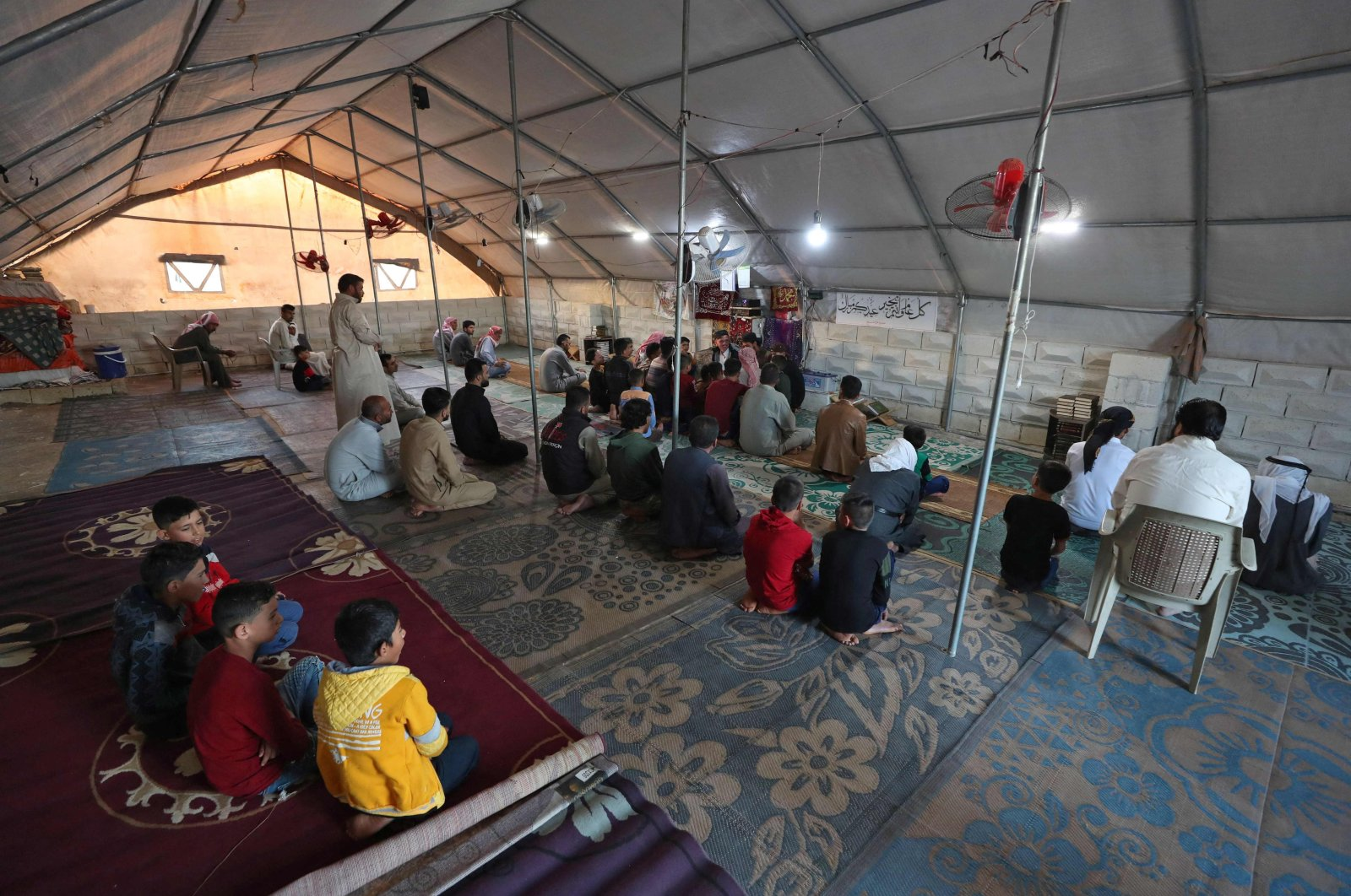 Displaced Syrians gather in a tent at the al-Tah camp for internally displaced persons (IDP) in Syria's northwestern province of Idlib, May 13, 2021. (AFP Photo)